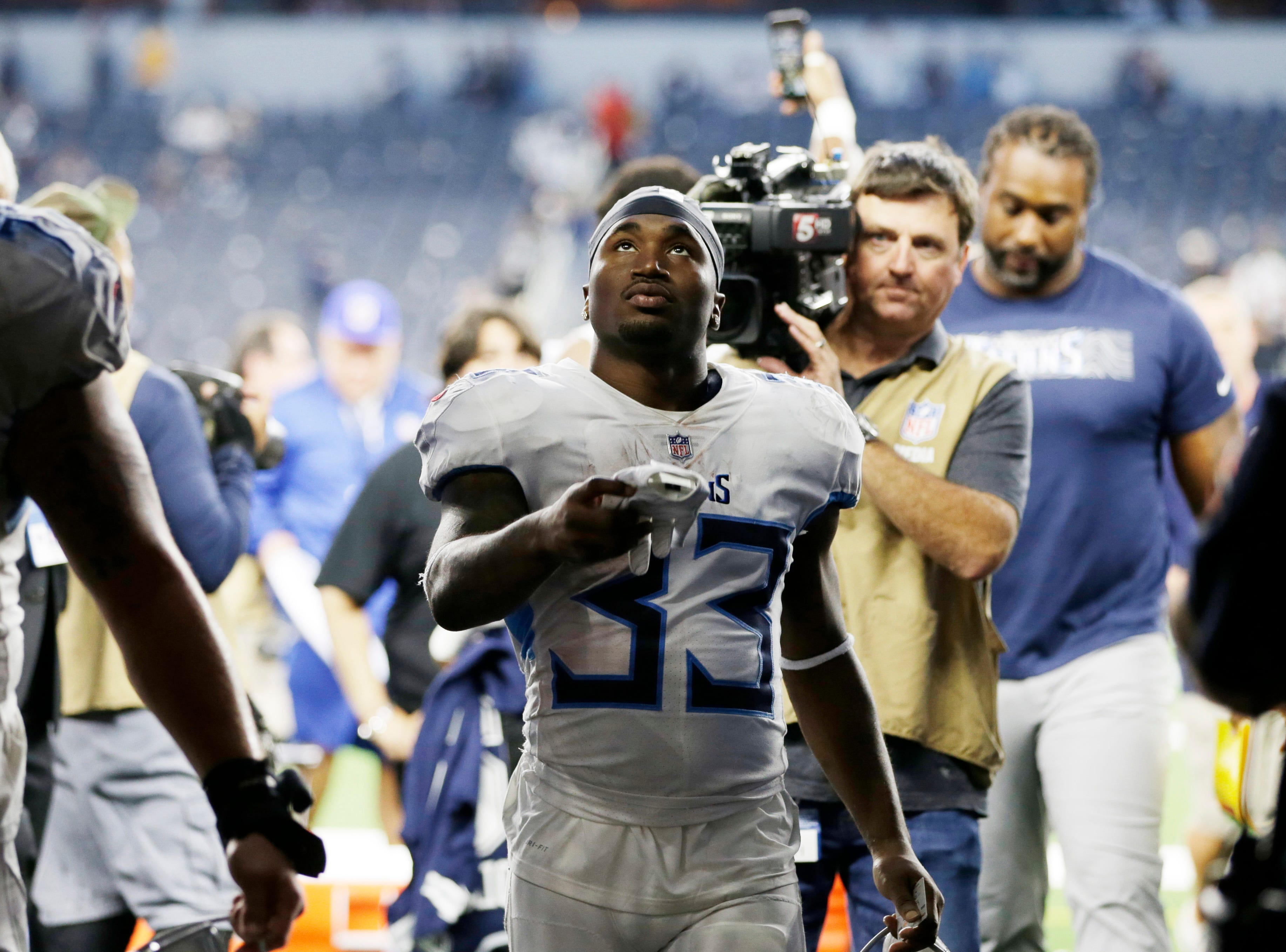 Tennessee Titans running back Dion Lewis (33) walks off the field after the game against the Dallas Cowboys at AT&T Stadium. Mandatory Credit: Tim Heitman-USA TODAY Sports