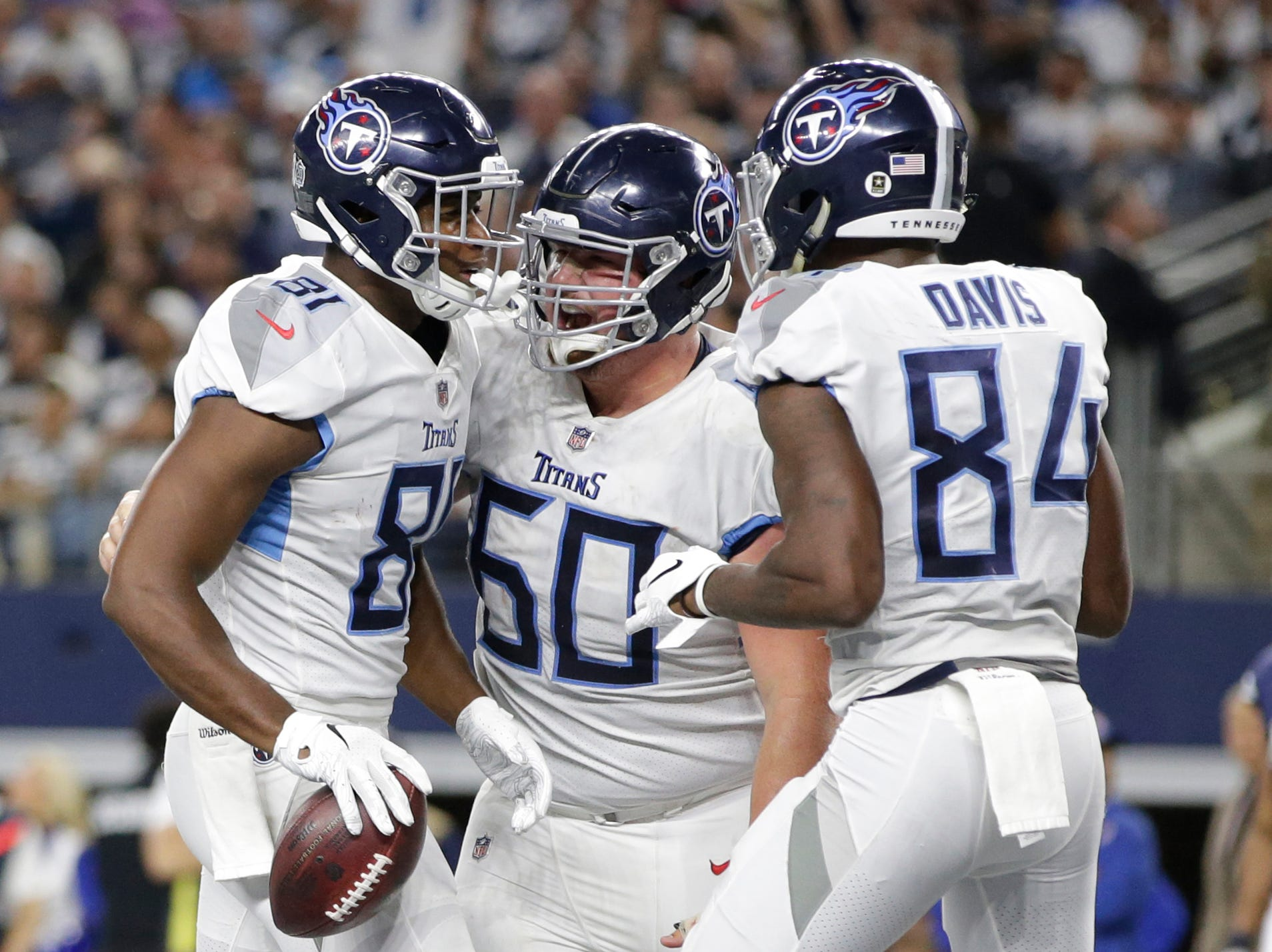 Tennessee Titans tight end Jonnu Smith (81) celebrates a touchdown with center Ben Jones (60) and wide receiver Corey Davis (84) in the fourth quarter at AT&T Stadium.