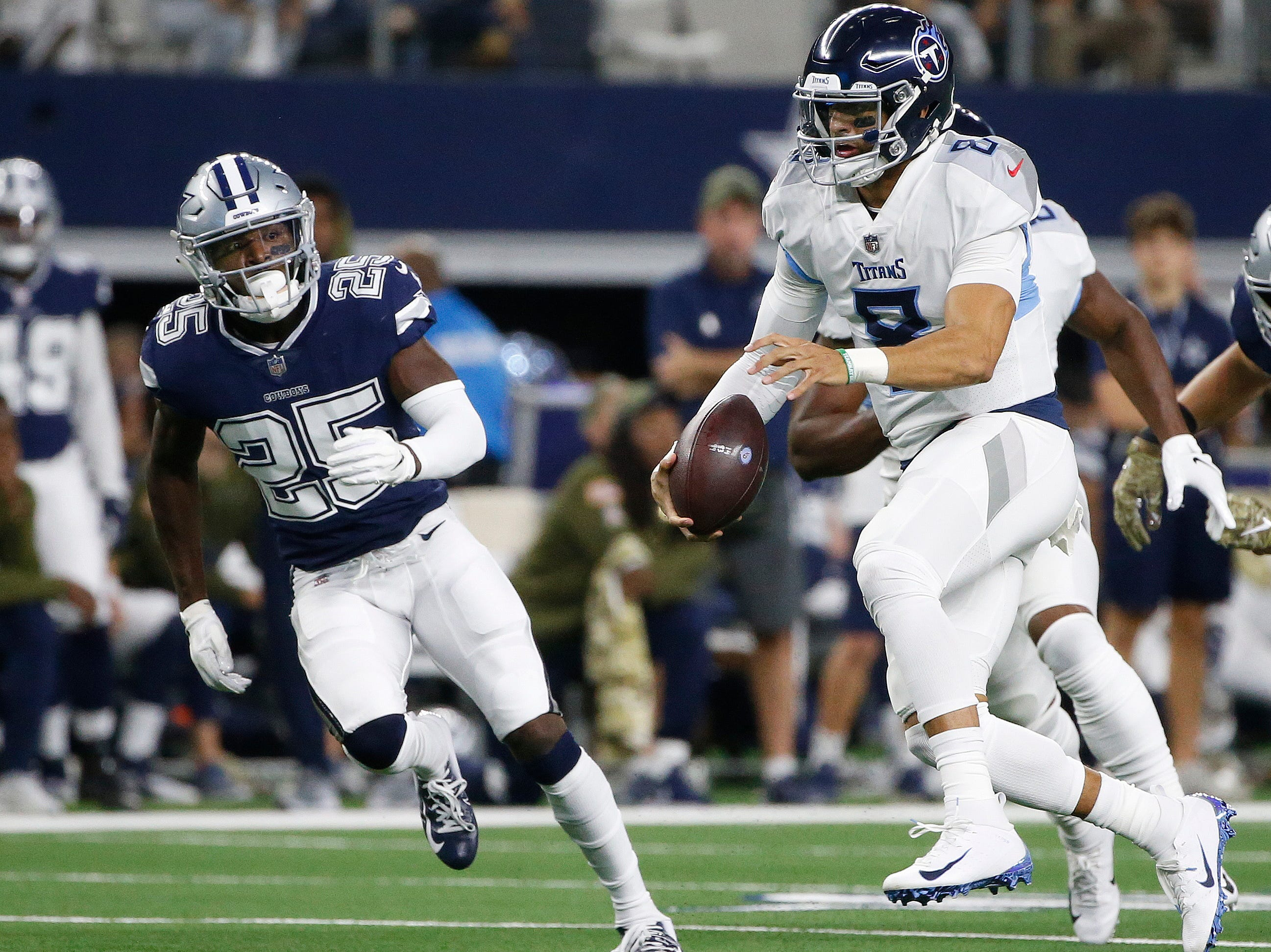 Tennessee Titans quarterback Marcus Mariota (8) runs out of the pocket against the Dallas Cowboys during the first half of an NFL football game, Monday, Nov. 5, 2018, in Arlington, Texas.