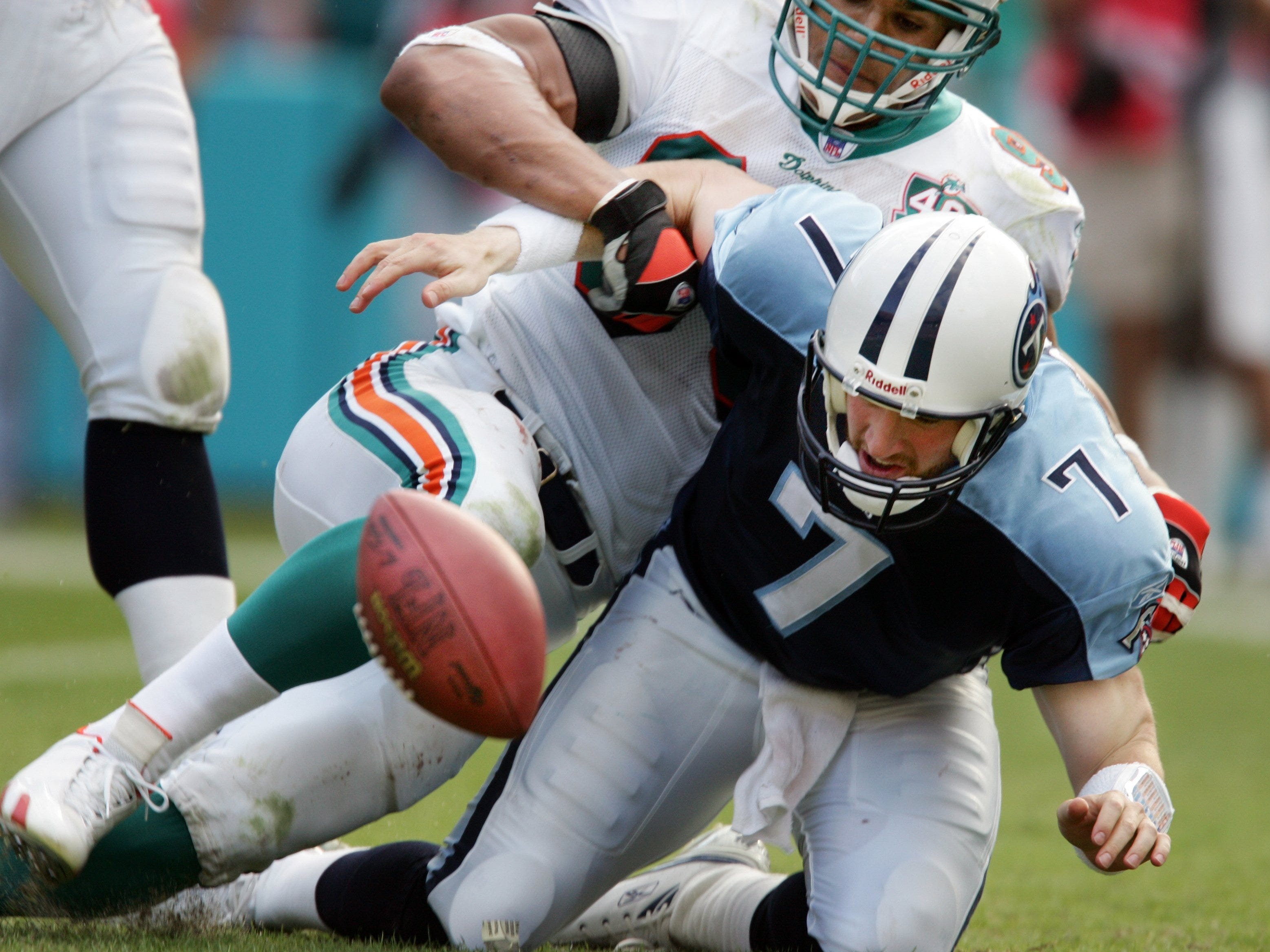 Billy Volek -- 10 games started as a Titans quarterback since 1981  Here, Dolphins defensive end Jason Taylor (99) strips the ball from Titans' quarterback Billy Volek (7) as as he is sacked in the fourth quarter during their game at Dolphins Stadium in Miami Gardens, Fla.December 24, 2005.