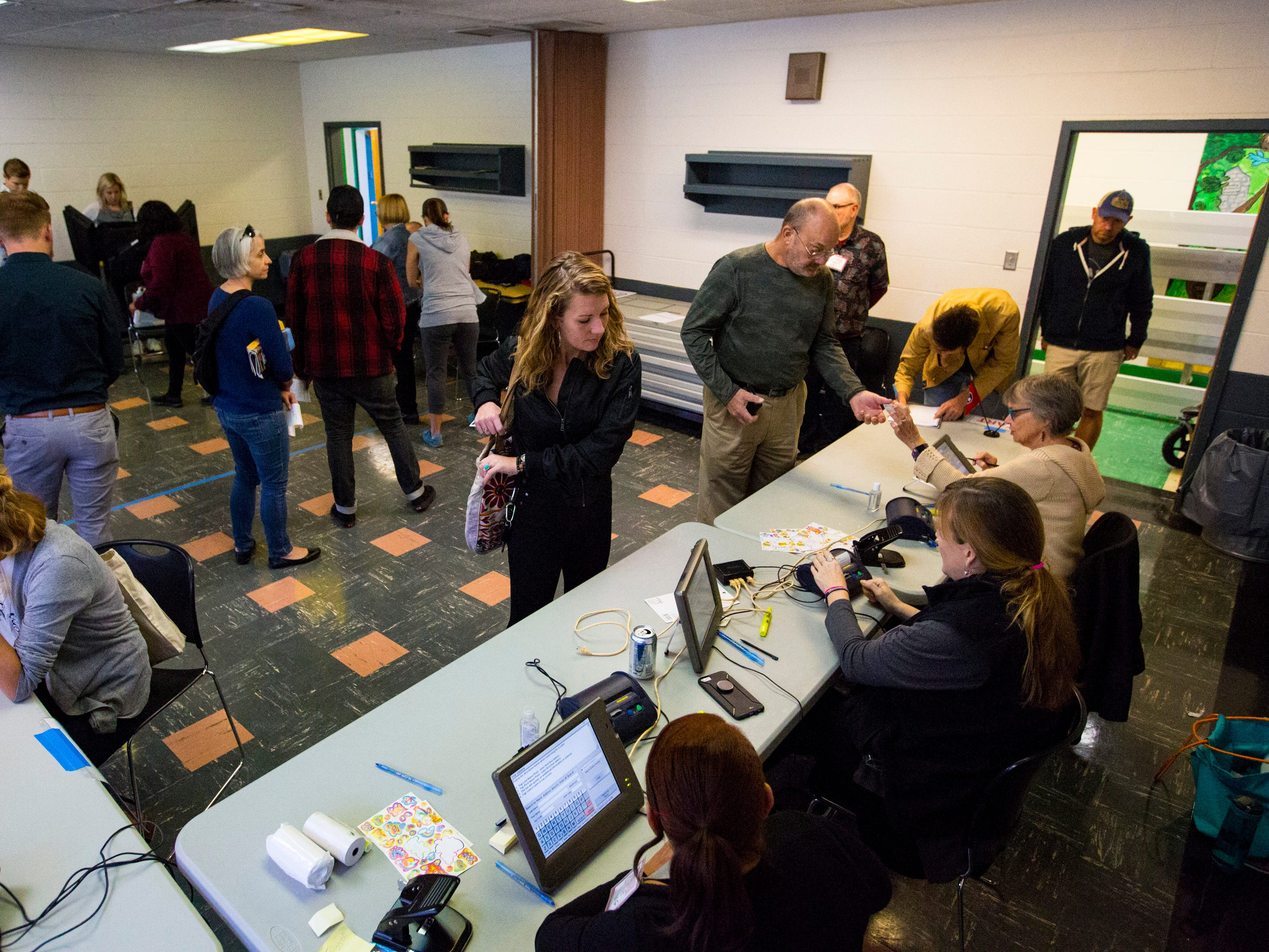 Voters check in at the Shelby Park Community Center polling place in Nashville on Tuesday, Nov. 6, 2018.