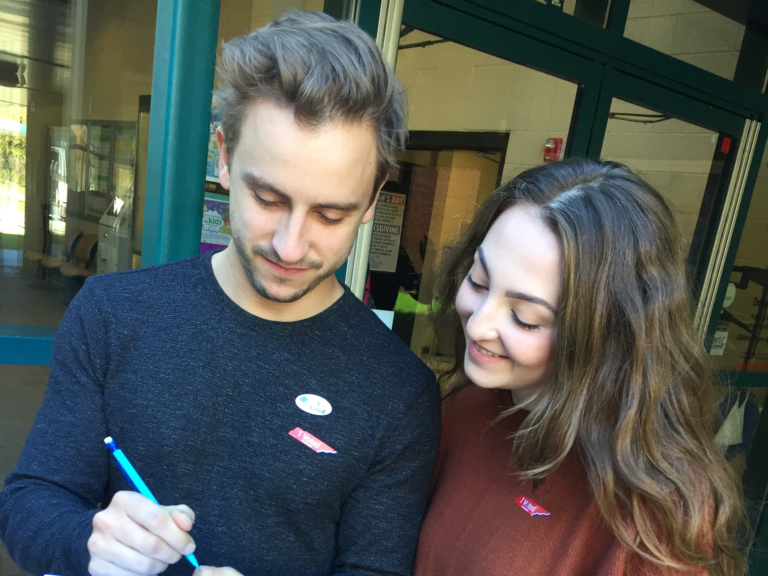 "Dave Mohr, 31, and Nicole Mohr, 26, stop to fill out an exit poll survey after voting at the Williamson County Recreation Center on Tuesday. We love voting,"" Dave Mohr said with a smile. ""We vote every chance we get."" Added Nicole Mohr: ""We always try to get all our friends to register, too. ""Yeah, we are those people,"" Dave Mohr said."