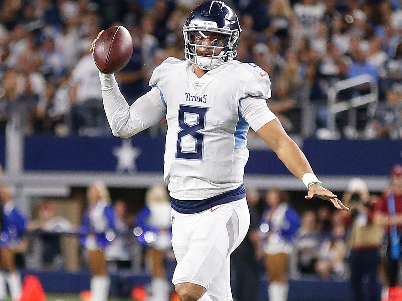 Tennessee Titans quarterback Marcus Mariota (8) runs out of the pocket against the Dallas Cowboys during the second half of an NFL football game, Monday, Nov. 5, 2018, in Arlington, Texas.