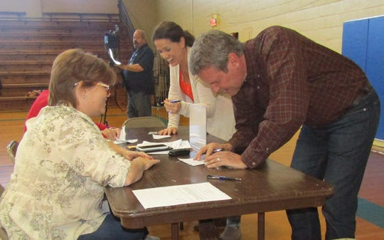 Republican gubernatorial candidate Bill Lee and his wife, Maria, check in with election officer Tetra Walker before voting at the Fairview Recreation Center on Tuesday morning, Nov. 6, 2018.