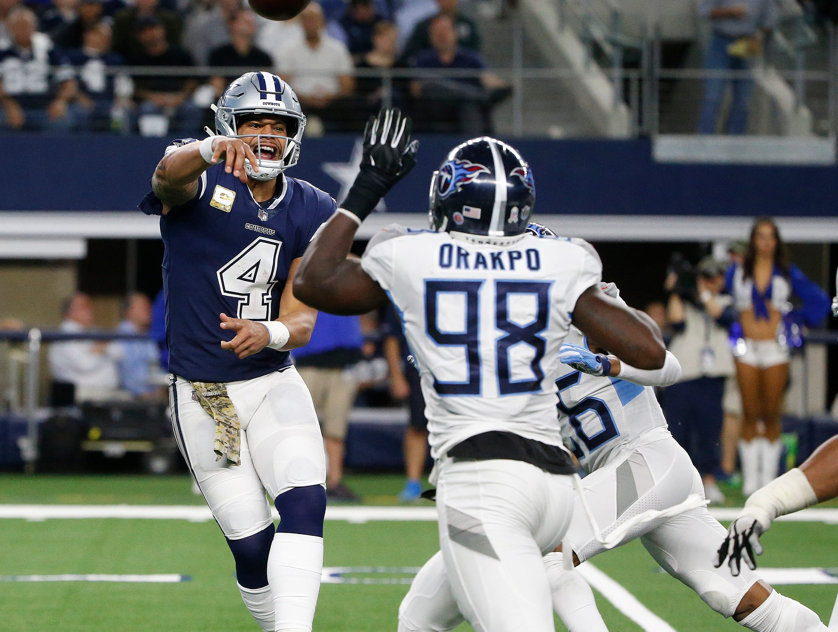 Dallas Cowboys quarterback Dak Prescott (4) works against the Tennessee Titans during the second half of an NFL football game, Monday, Nov. 5, 2018, in Arlington, Texas.