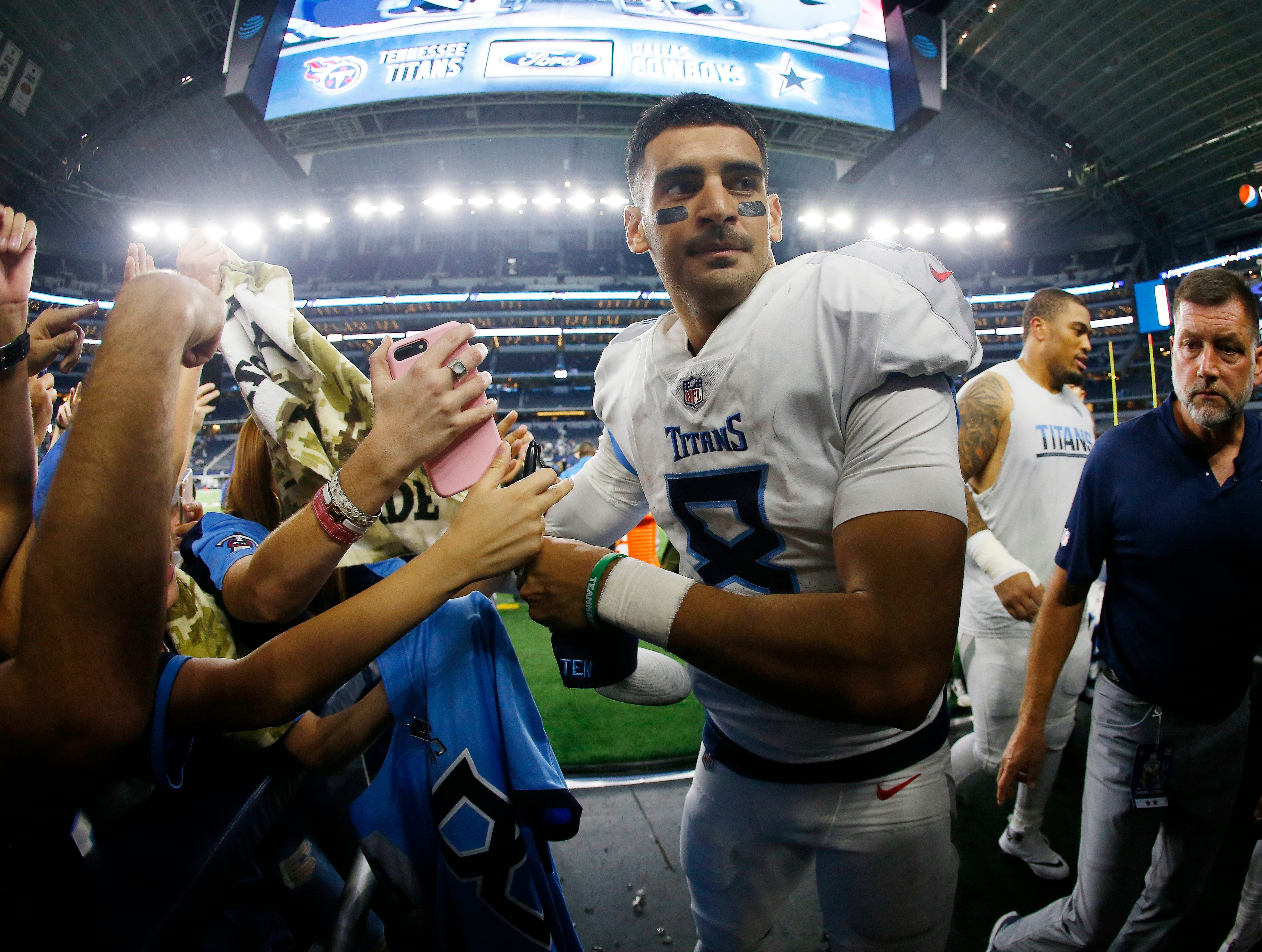 Tennessee Titans quarterback Marcus Mariota (8) greets fans after an NFL football game against the Dallas Cowboys, Monday, Nov. 5, 2018, in Arlington, Texas. The Tennessee Titans won 28-14.