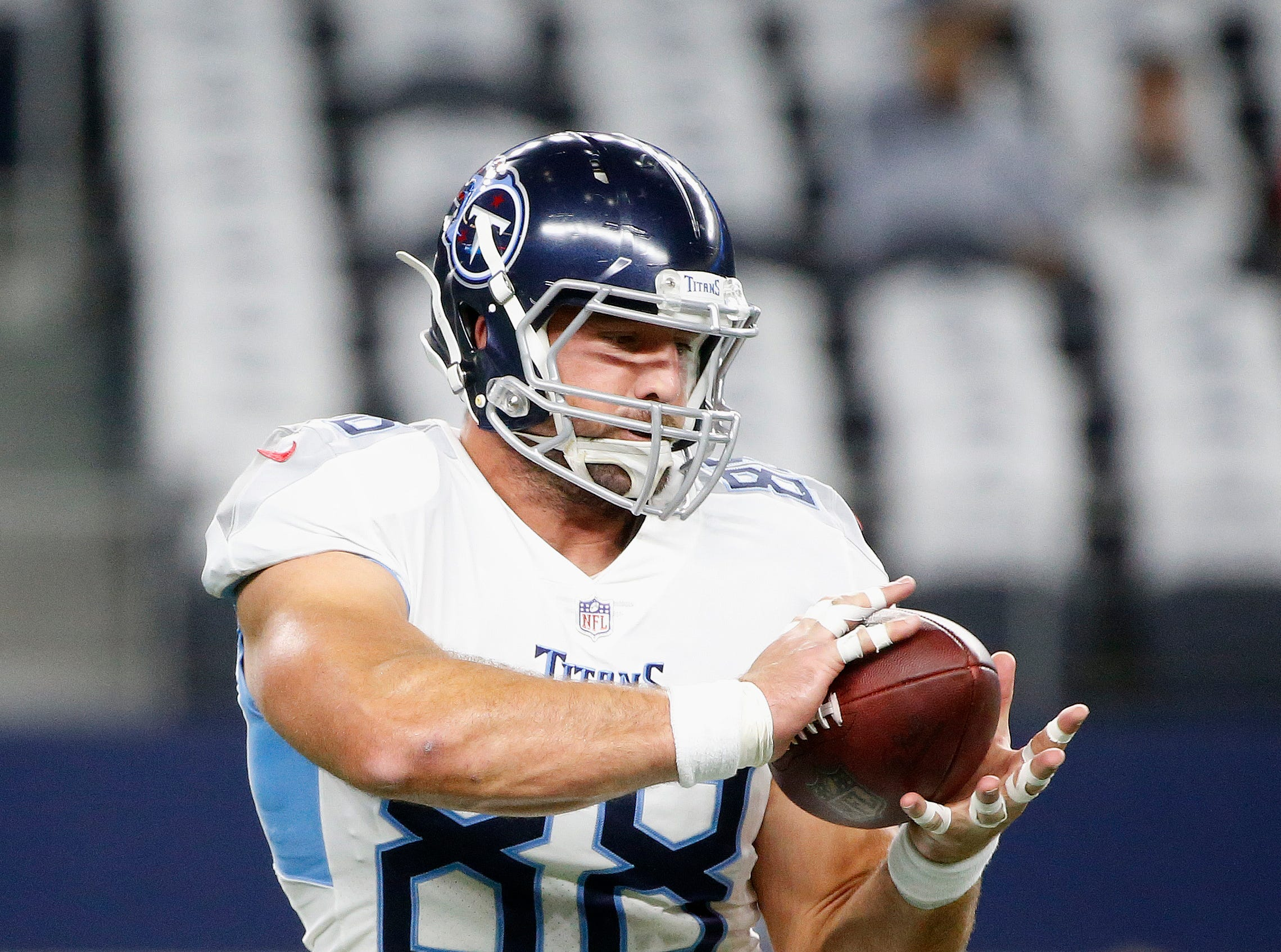 Tennessee Titans tight end Luke Stocker (88) warms up before the first half of an NFL football game between the Dallas Cowboys and the Tennessee Titans, Monday, Nov. 5, 2018, in Arlington, Texas.