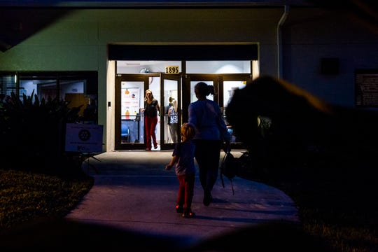 Voters trickle in and out before the polls close at Veteran's Community Park in Naples on Tuesday, Nov. 6, 2018.