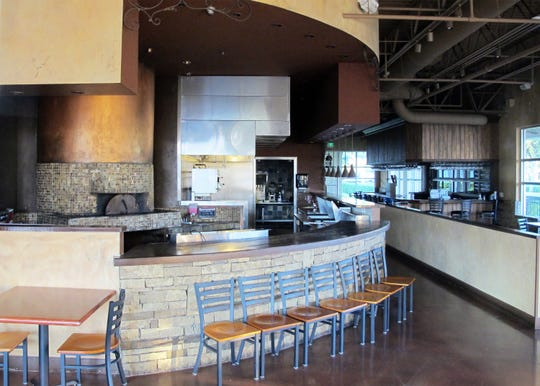 The 3,400-square-foot end unit vacated in September by Cafe Alfredo remains available for lease with a wood-fired pizza oven, left, and an indoor-outdoor bar at the Galleria Shoppes at Vanderbilt in North Naples.