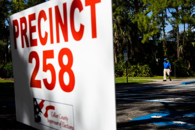 Voters trickle in and out during the slow lunch period at Veteran's Community Park in Naples on Tuesday, Nov. 6, 2018.