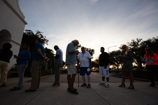 Voters wait for the polls to open Tuesday morning, Nov. 6, 2018, at the Collier County Library Headquarters branch in North Naples.