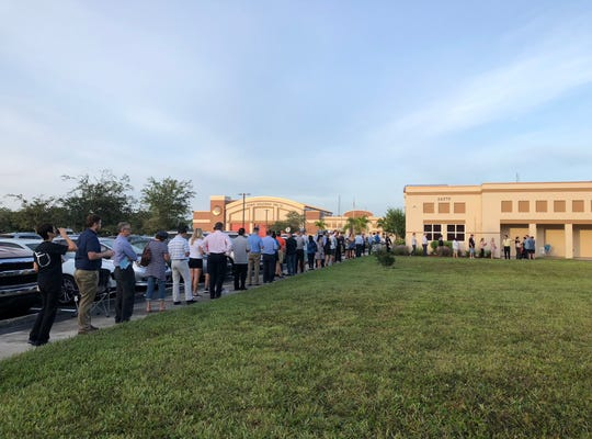 Voters are lined up outside precinct 313 in Collier County on Tuesday, Nov. 6, 2018.