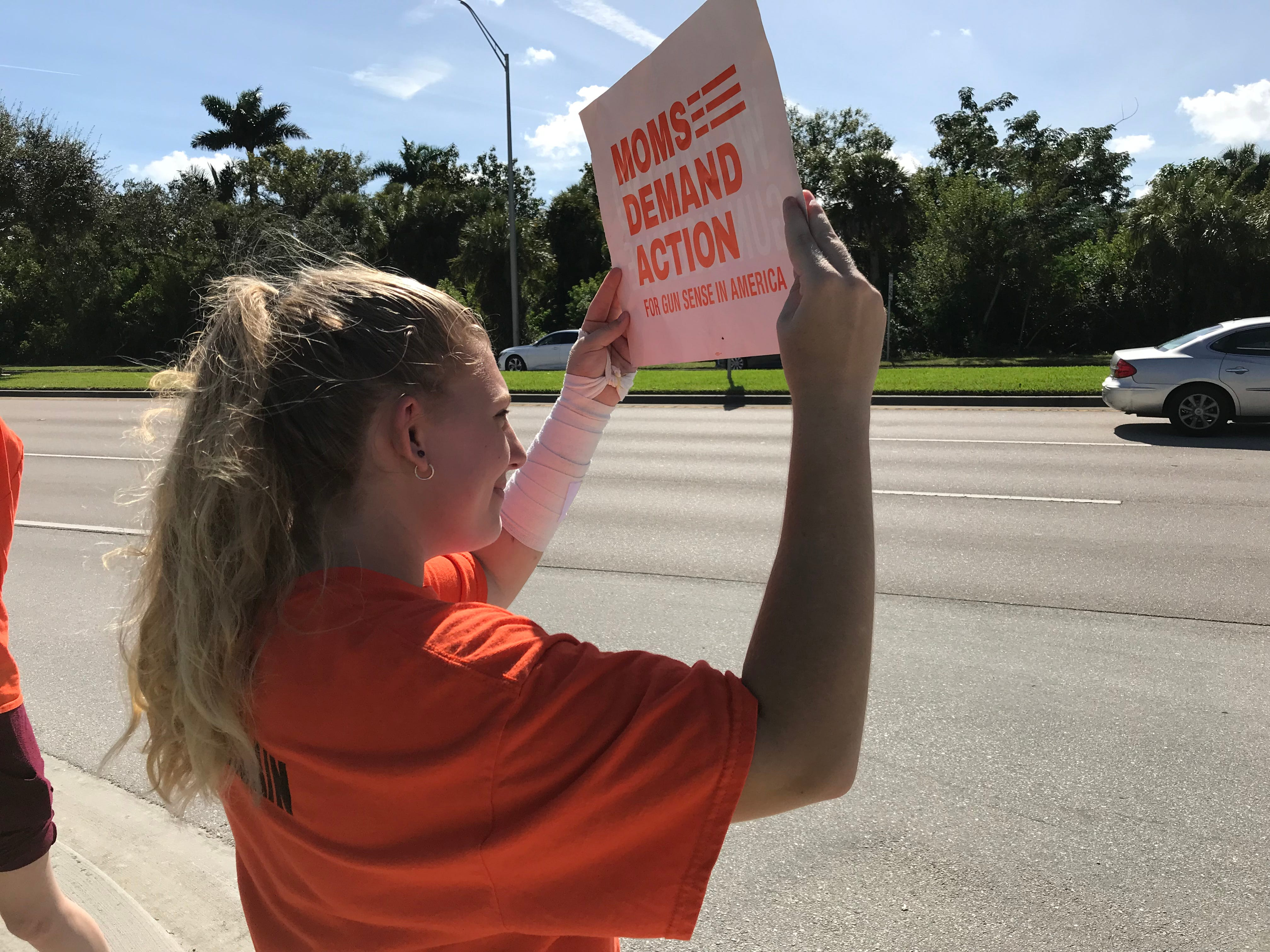 Destiny Gray, 15, a sophomore at Naples High School, holds up a sign during an Election Day student walkout at Freedom Park in Naples on Tuesday, Nov. 6, 2018.