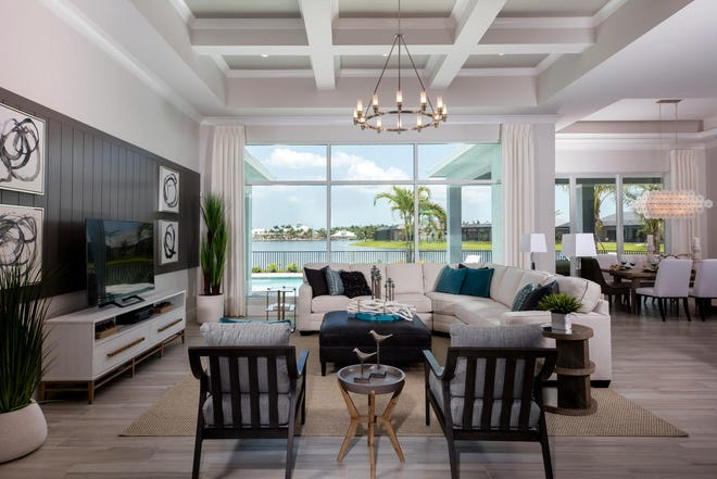 Florida Lifestyle Homes' Key Largo model at Naples Reserve boasts a waterfront view which enhances the home's interior detailing as shown from the great room.