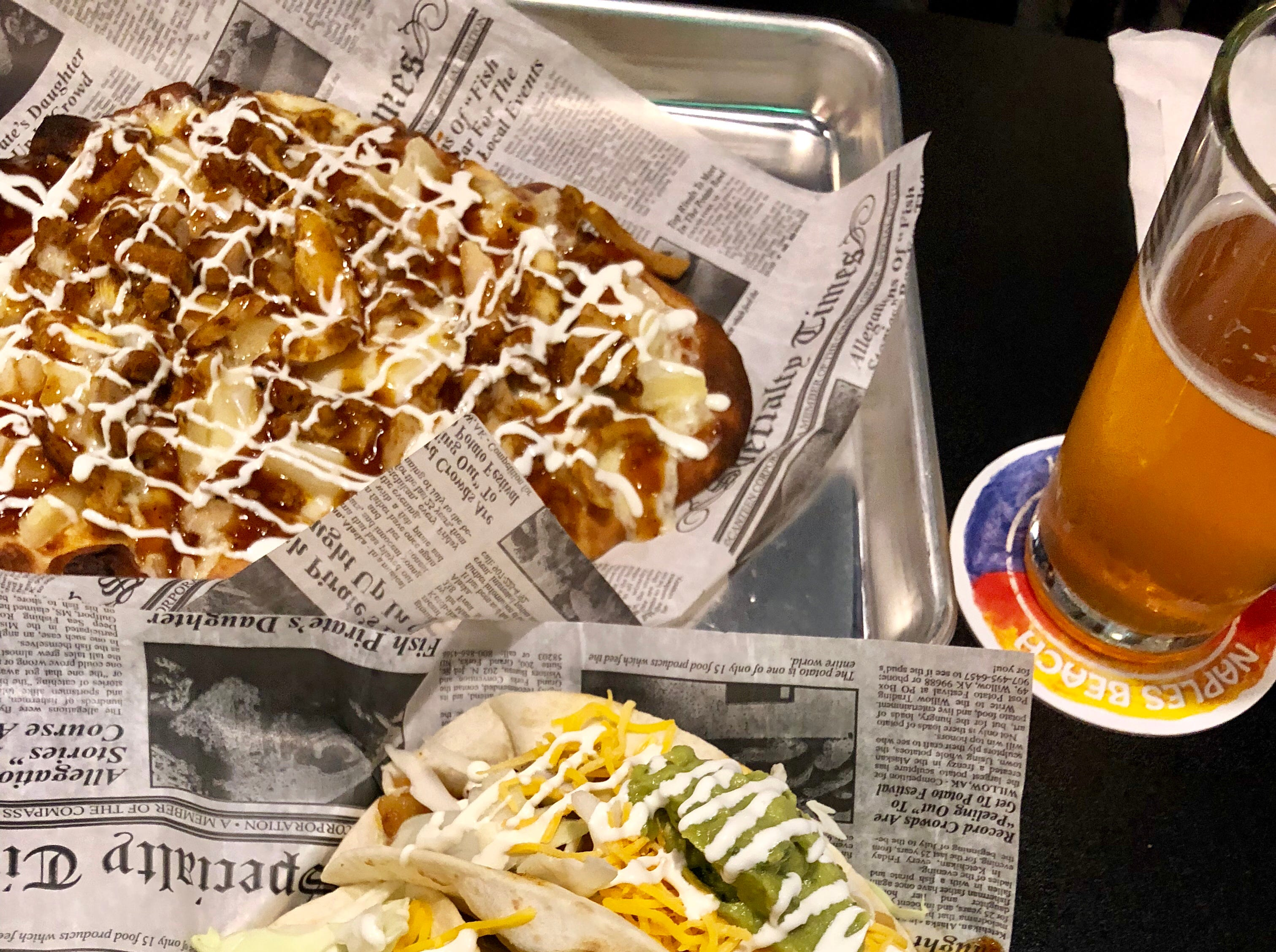 Barbacoa beef street tacos and Korean barbecue chicken flatbread from Southern Latitudes Brewpub in Naples.