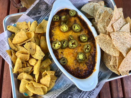 Southern Latitudes Brewpub in Naples serves Cincinnati-style chili dip with cream cheese underneath, cheddar cheese on top.