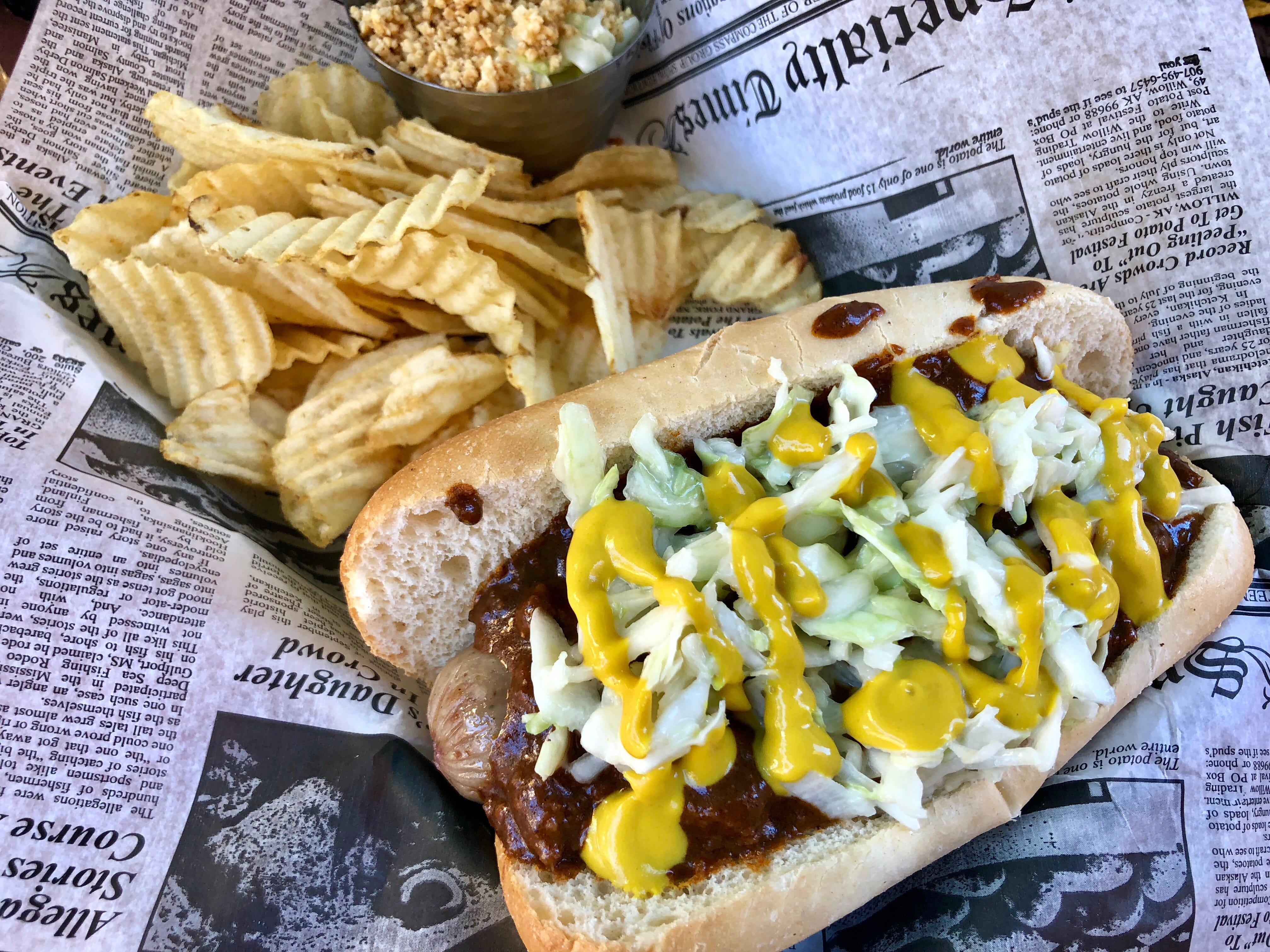 A Carolina slaw dog — coleslaw, chili and mustard atop a Guinness-infused hot dog — at Southern Latitudes