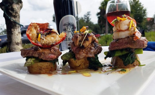 Cafe Blu in Naples this week features a special surf and turf dish of prime beef filet mignon topped with a lobster tail, shrimp and foie gras, and finished with a black truffle butter sauce.