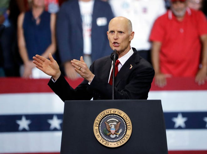 Florida Gov. Rick Scott gestures as he appears with President Donald Trump during a rally Wednesday, Oct. 31, 2018, in Estero. Scott defeated incumbent Bill Nelson to become Florida's new U.S. senator.