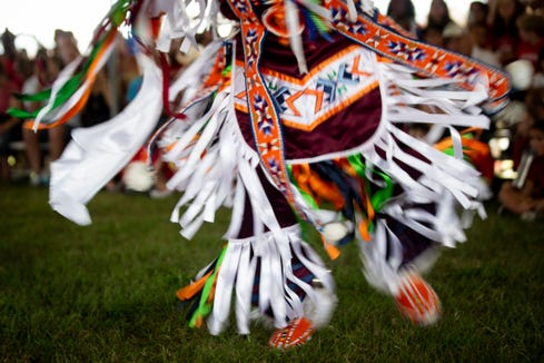 Native Pride Dancer Arlan Whitebreast, from the Meskwaki tribe in Iowa, demonstrates a grass dance during the 21st annual American Indian Arts Celebration on Friday, November 2, 2018, on the grounds of the Ah-Tah-Thi-Ki museum in the Big Cypress Seminole Indian Reservation.