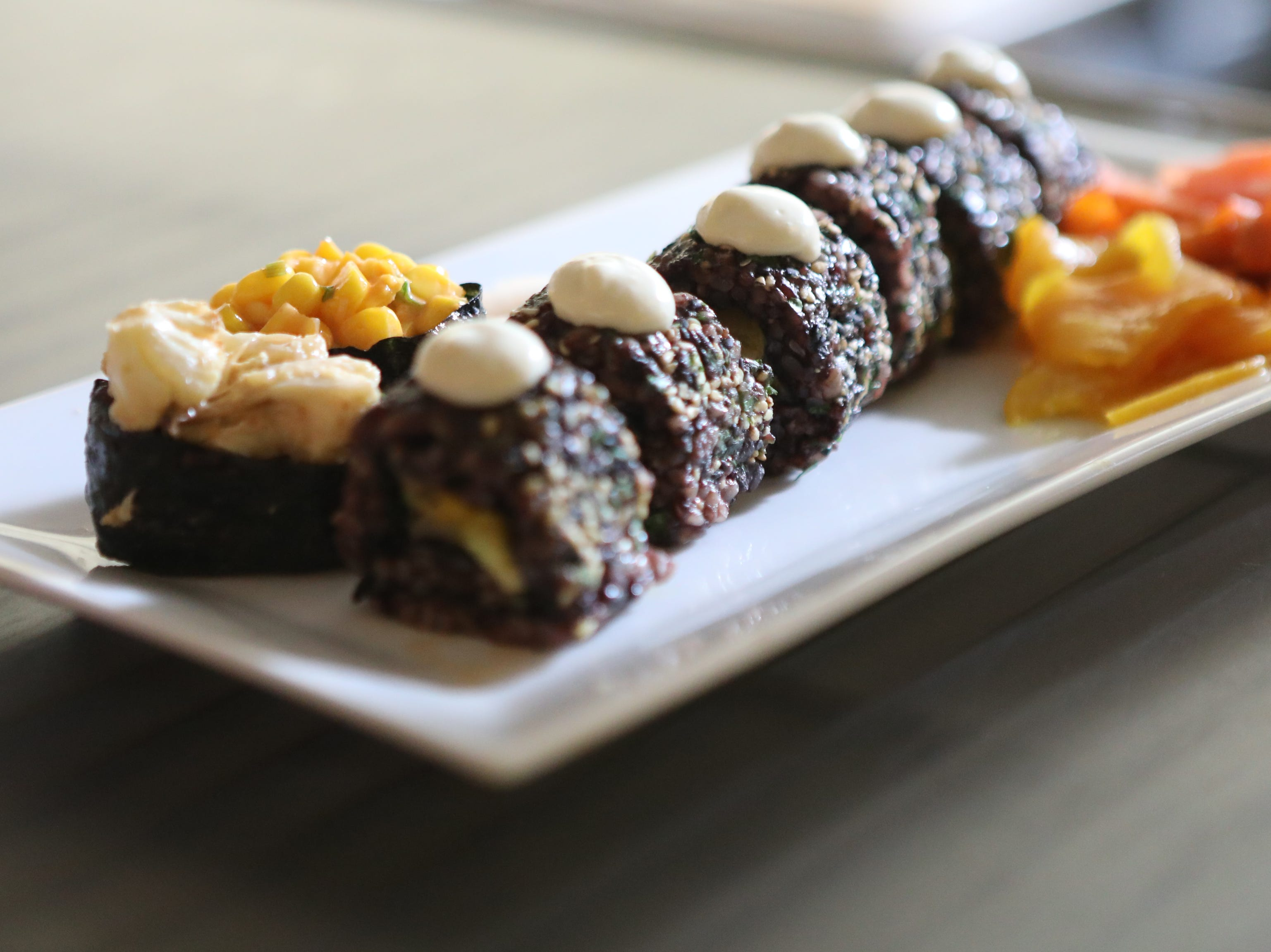 The vegan maki roll, sashimi and gunkan maki are ready to serve.