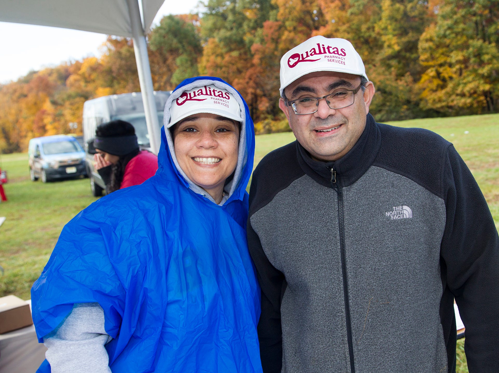 Anita and John of Qualitas. RWJBarnabas Health Running with the Devils 5K Run and Family Fun Walk at South Mountain Recreation in West Orange. 10/03/2018