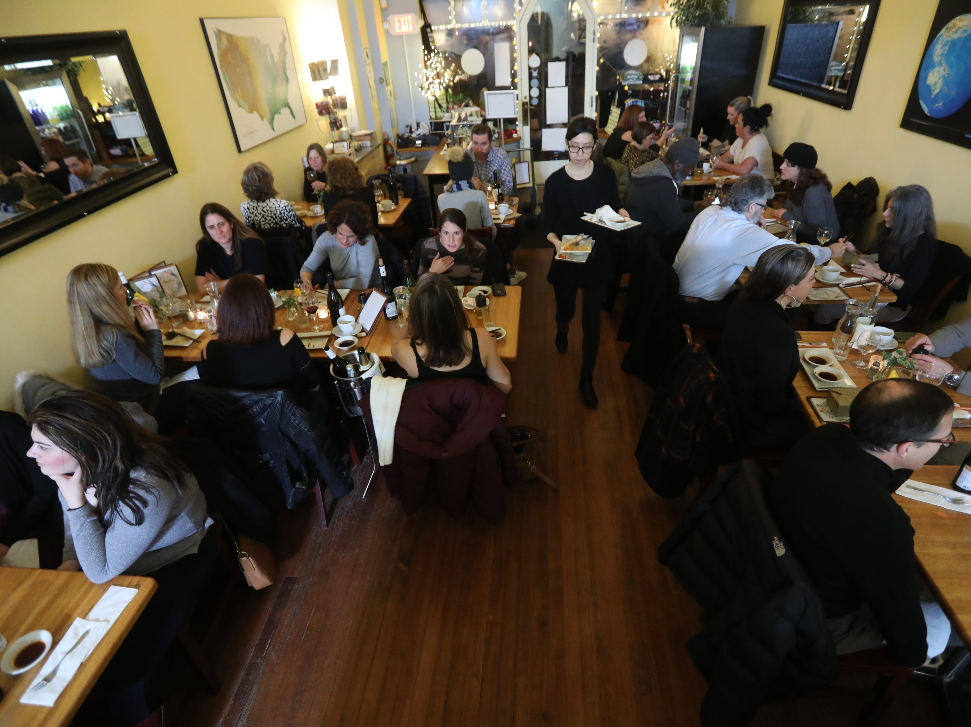 Those lucky enough to get a seat at a sold out pop-up dinner, enjoy their food at Mundo Vegan in Montclair.