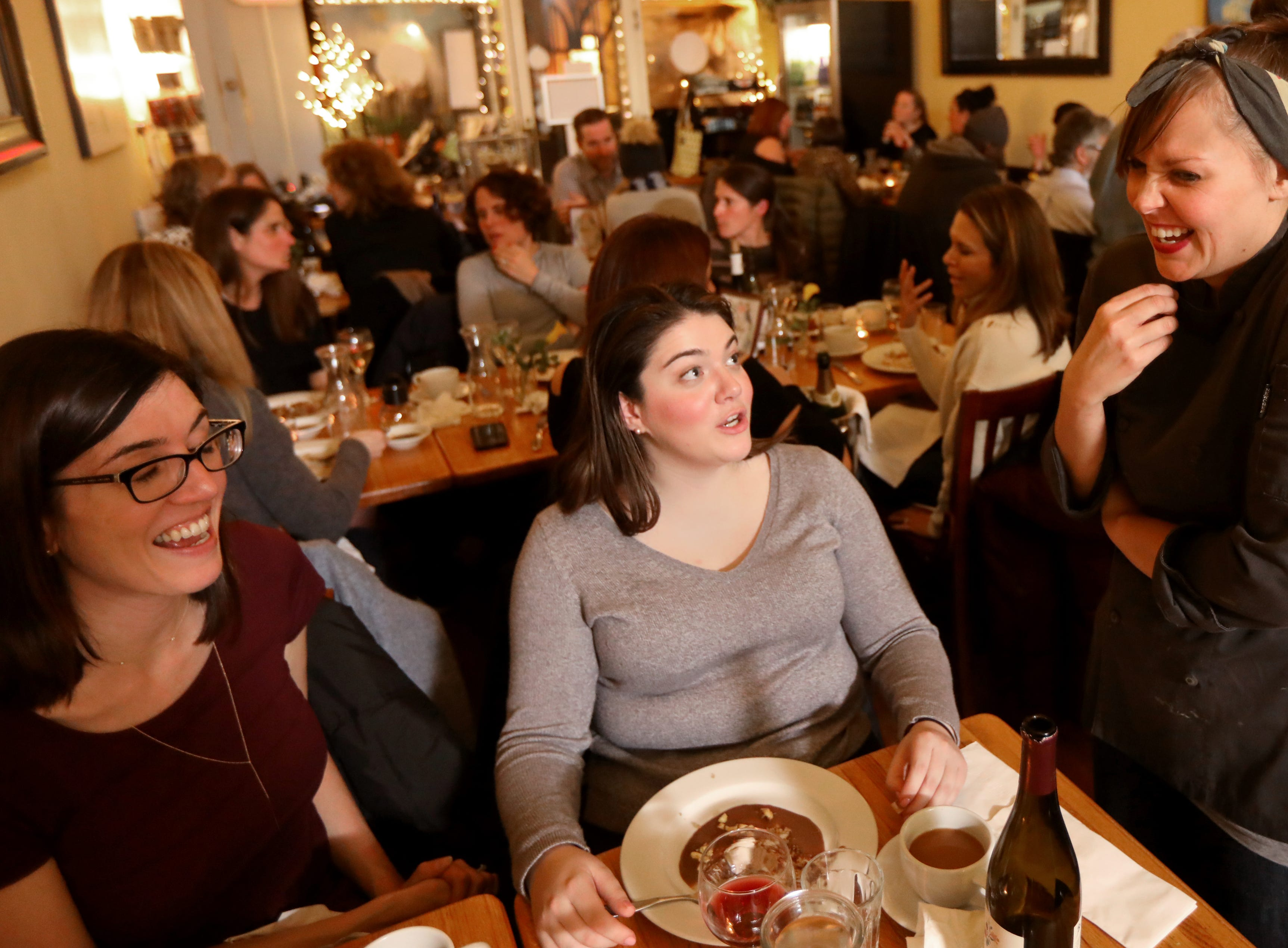 Lindsey Duffy, of Verona and Chelsea Meade, of Clifton, share a laugh with Sally Owens at a pop-up dinner earlier this year.