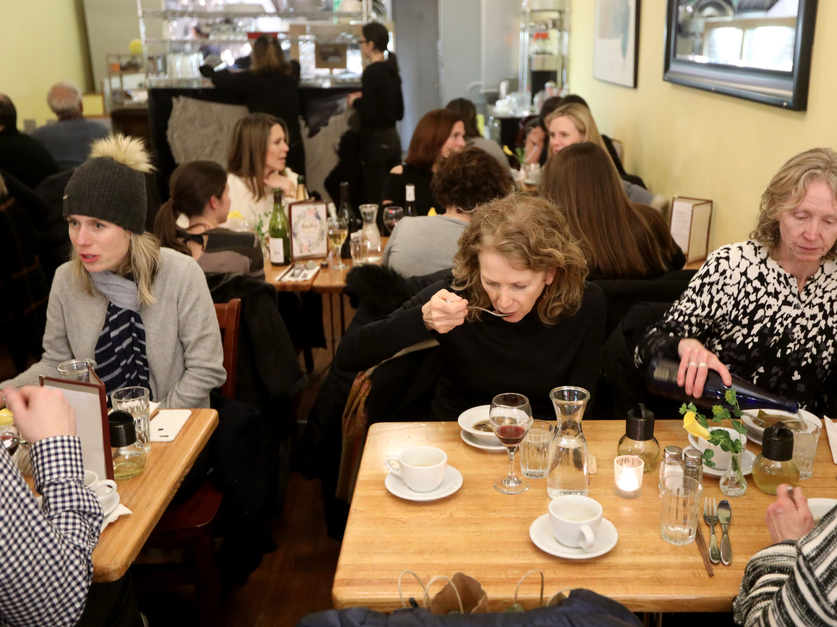 A packed restaurant enjoys a pop-up dinner earlier this year.