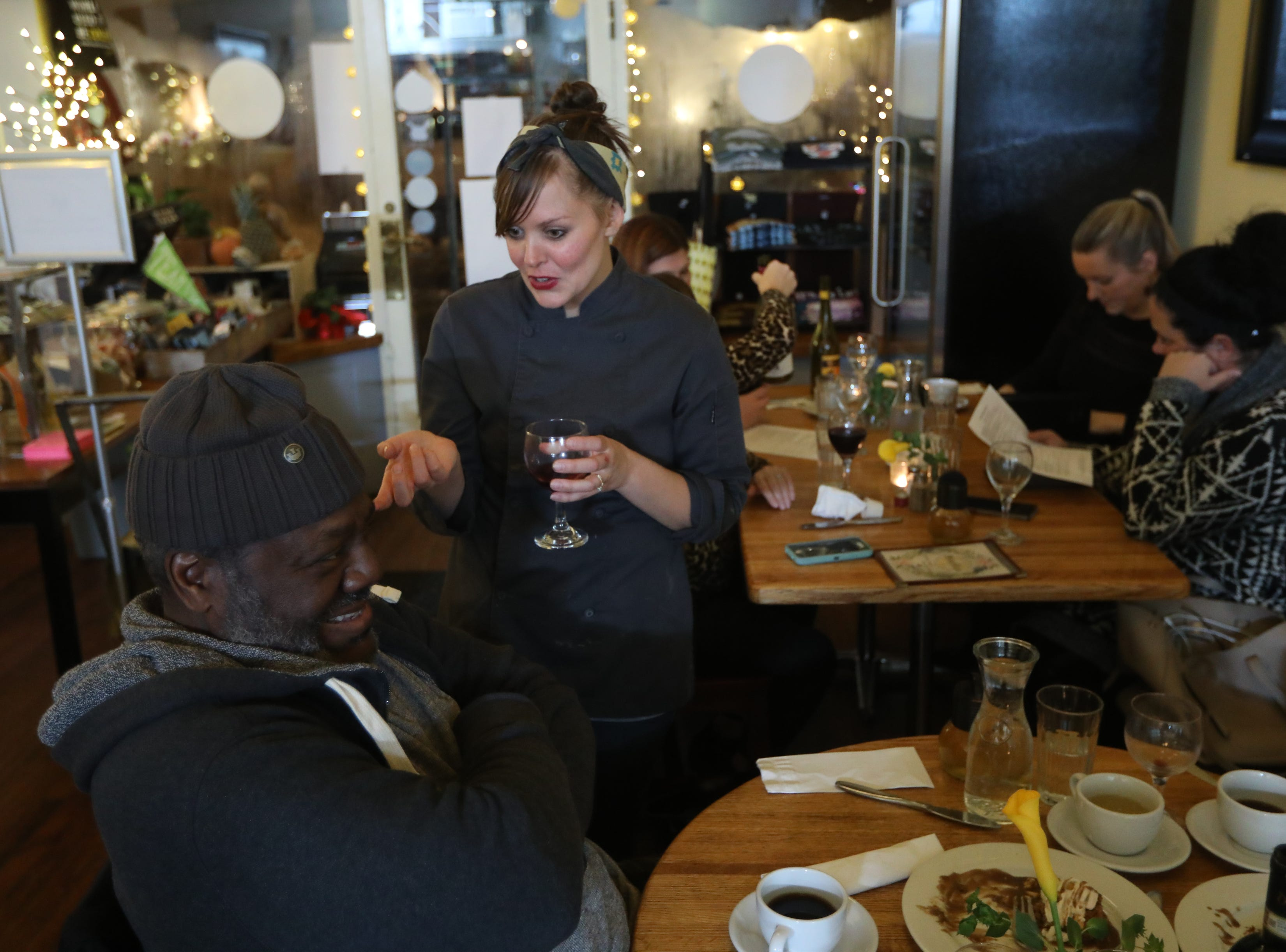 Frankie Faison, of Bloomfield speaks with chef, Sally Owens at a pop-up dinner earlier this year.