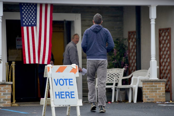 A voter arrives at his polling precinct, Community Fire Co. 1 on Parish Drive in Wayne, on the morning of Nov. 6.
