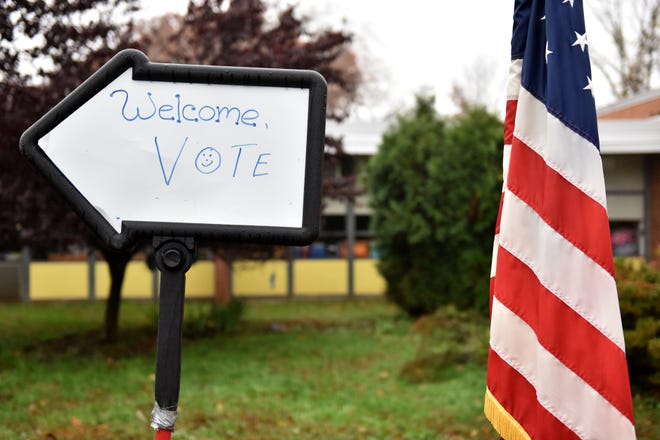 A sign points voters to the polling area at Ryerson School at 30 McClelland Avenue in Wayne on Tuesday morning November 6, 2018.
