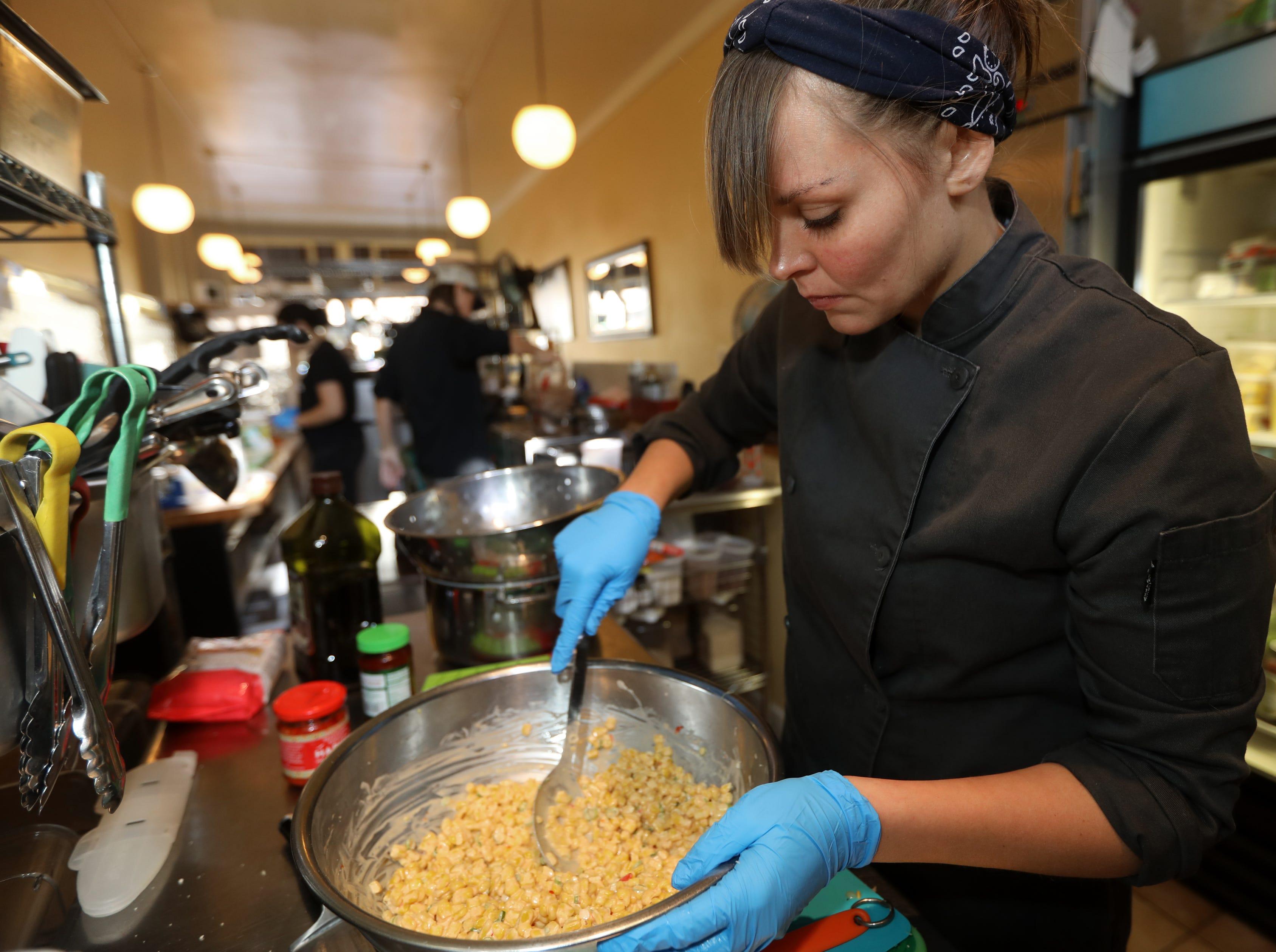 Sally Owens prepares spicy corn for her vegan gunkan maki.