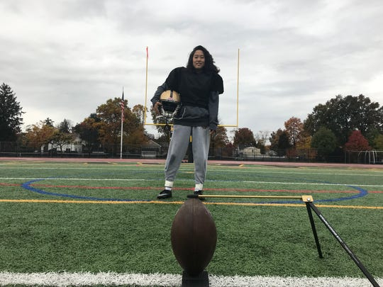 River Dell kicker Damiah Kahng is believed to be the first Bergen County girl to score a point in the state football playoffs. She made her ninth PAT of the season (10th career) in the Golden Hawks' North 1, Group 3 win over Pascack Valley on Friday, Nov. 2, 2018.