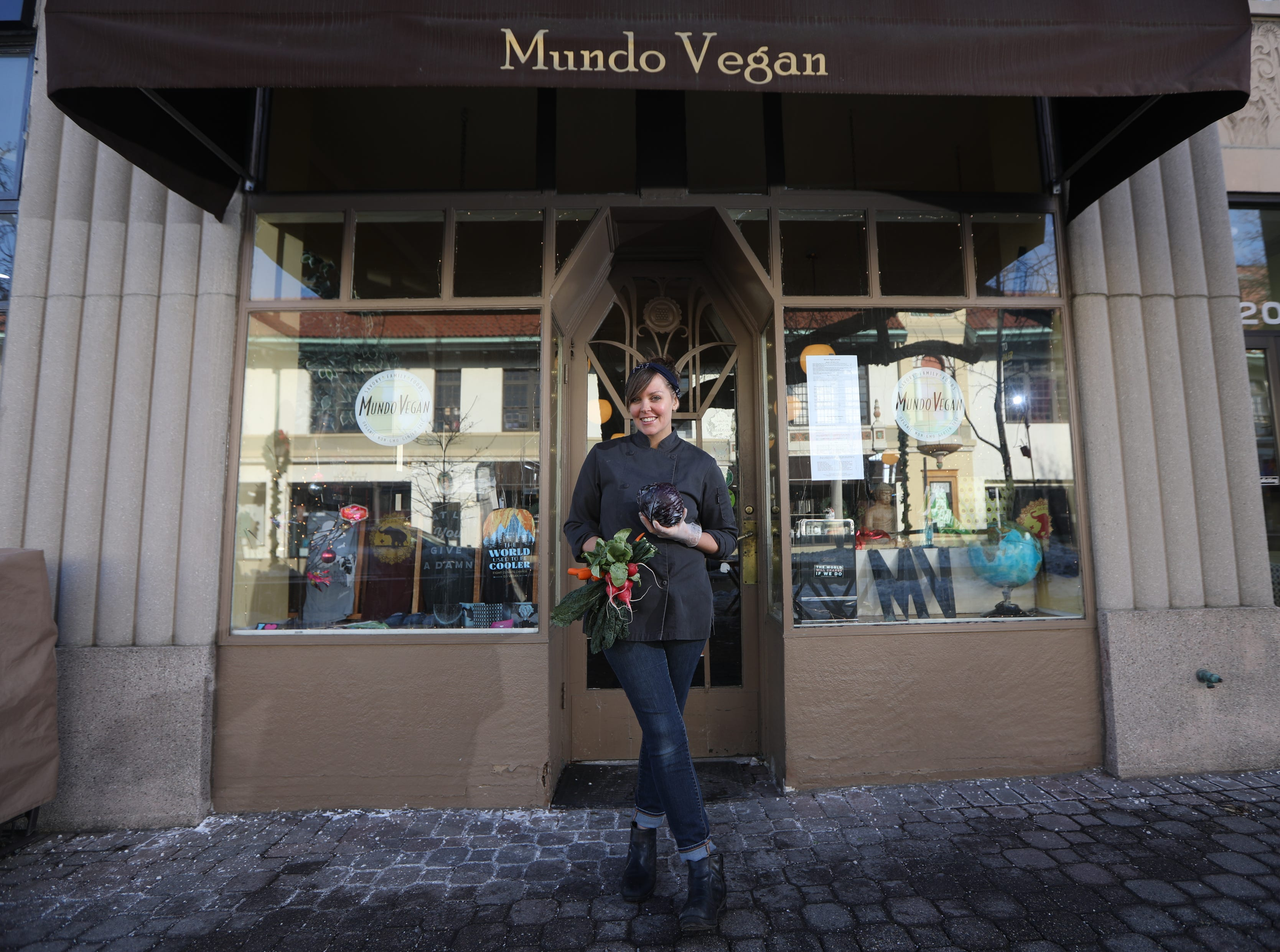 Sally Owens poses for a photograph in front on Mundo Vegan, in Montclair, where she holds pop-up dinners once a month.