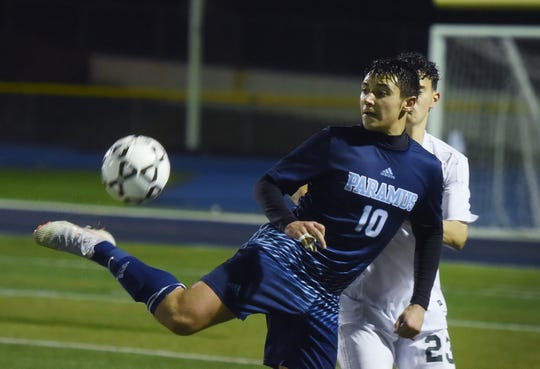 Justin Behnke (no. 10) of Paramus kicks the ball backwards against Montville in the second half during the NJSIAA North 1 Group 3 boys soccer semifinal at Paramus High School on 11/5/18.