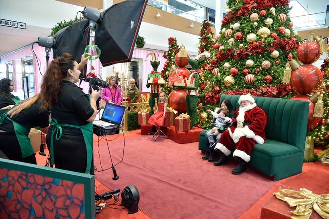 Santa was quite busy having his photo taken with shoppers on Black Friday on Nov. 24, 2017 at the Willowbrook Mall in Wayne.