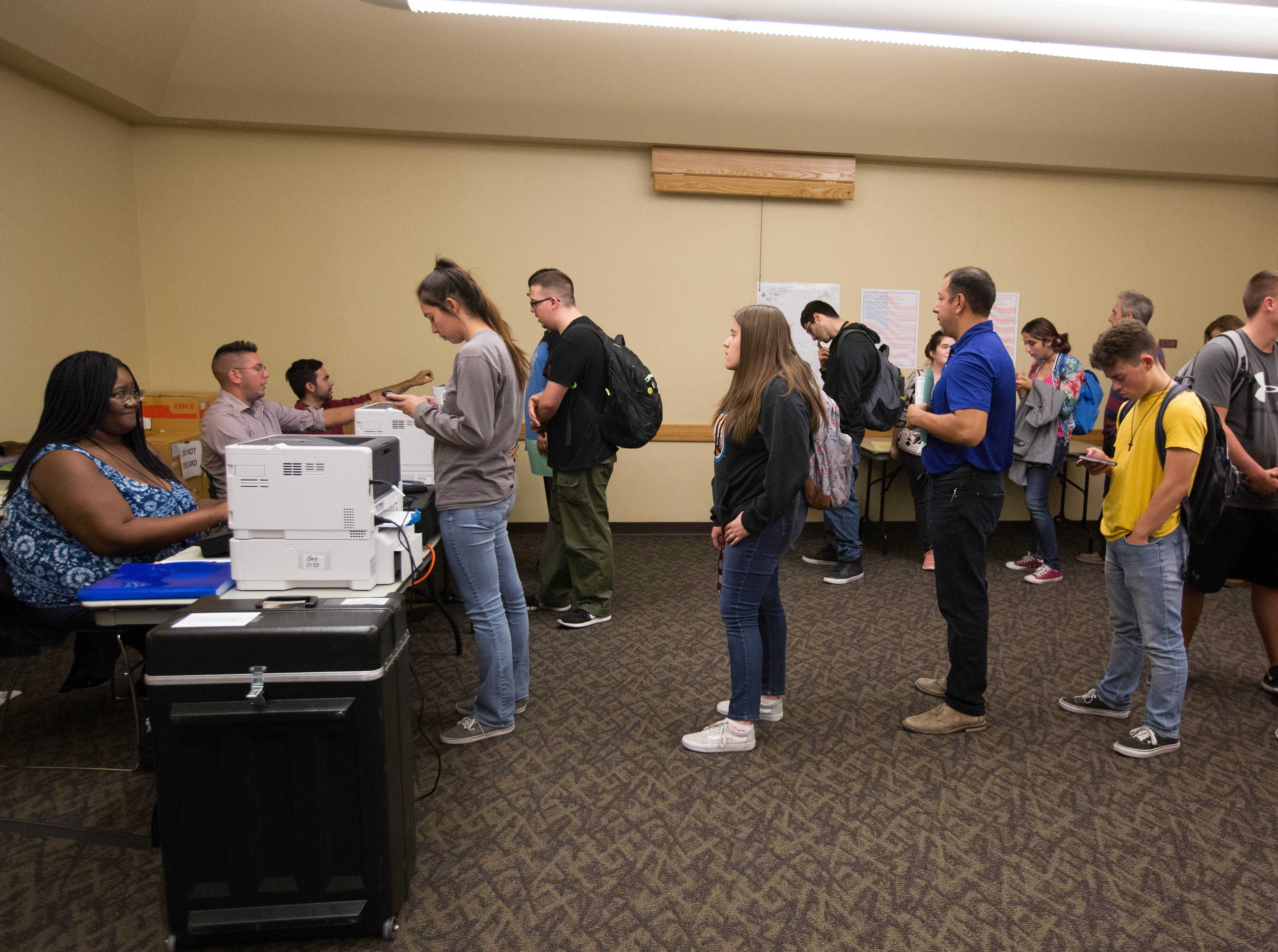 Voters line up at the polling station at Corbett Center at New Mexico State University, Tuesday November 6, 2018.