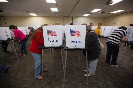 Voters fill out their ballots at the Doña Ana County Government Center during the midterm elections, Tuesday November 6, 2018.