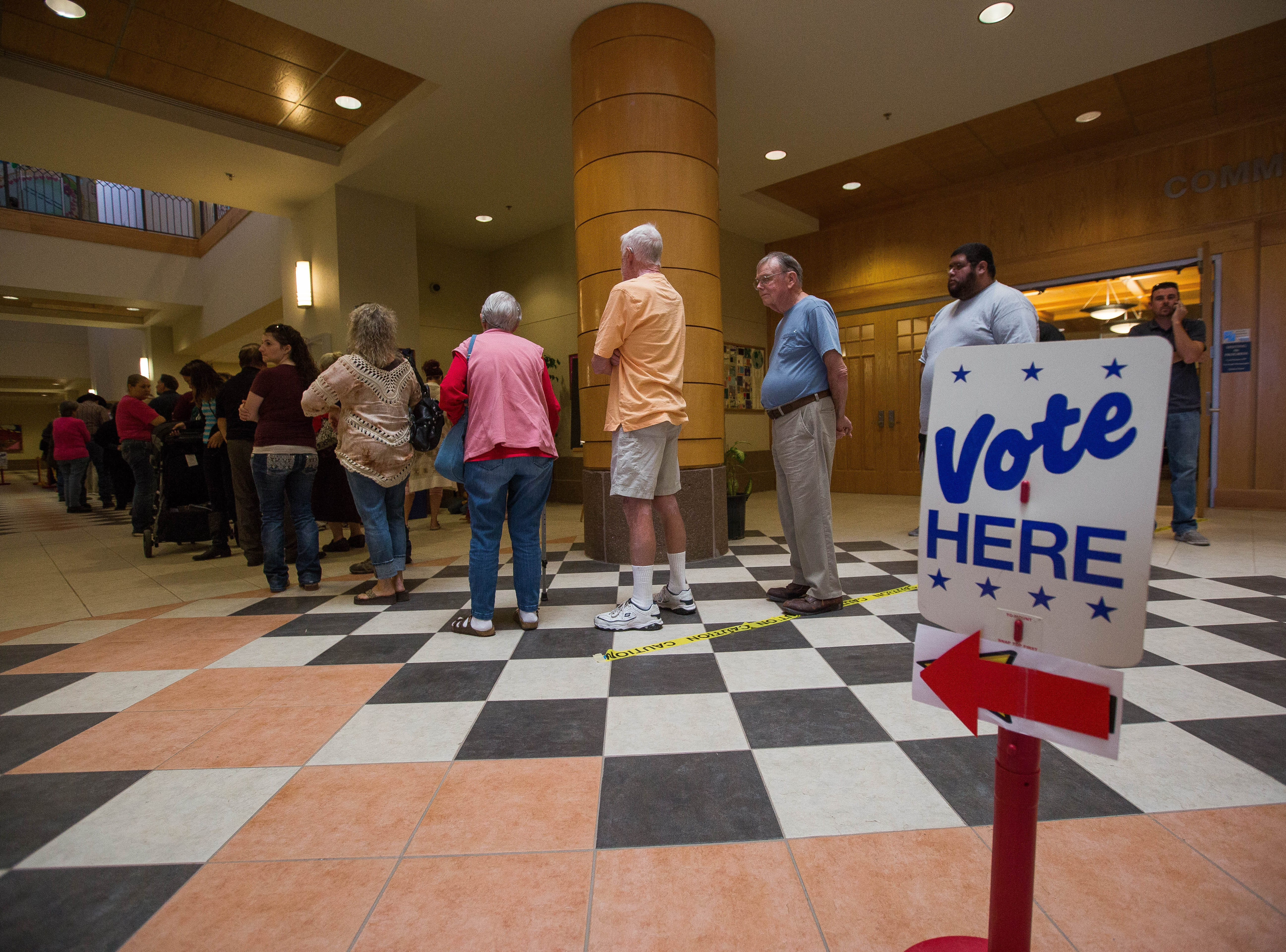 Voters line up at the Doña Ana County Government Building on Tuesday Nov. 6, 2018 to cast a ballot in the midterm elections.