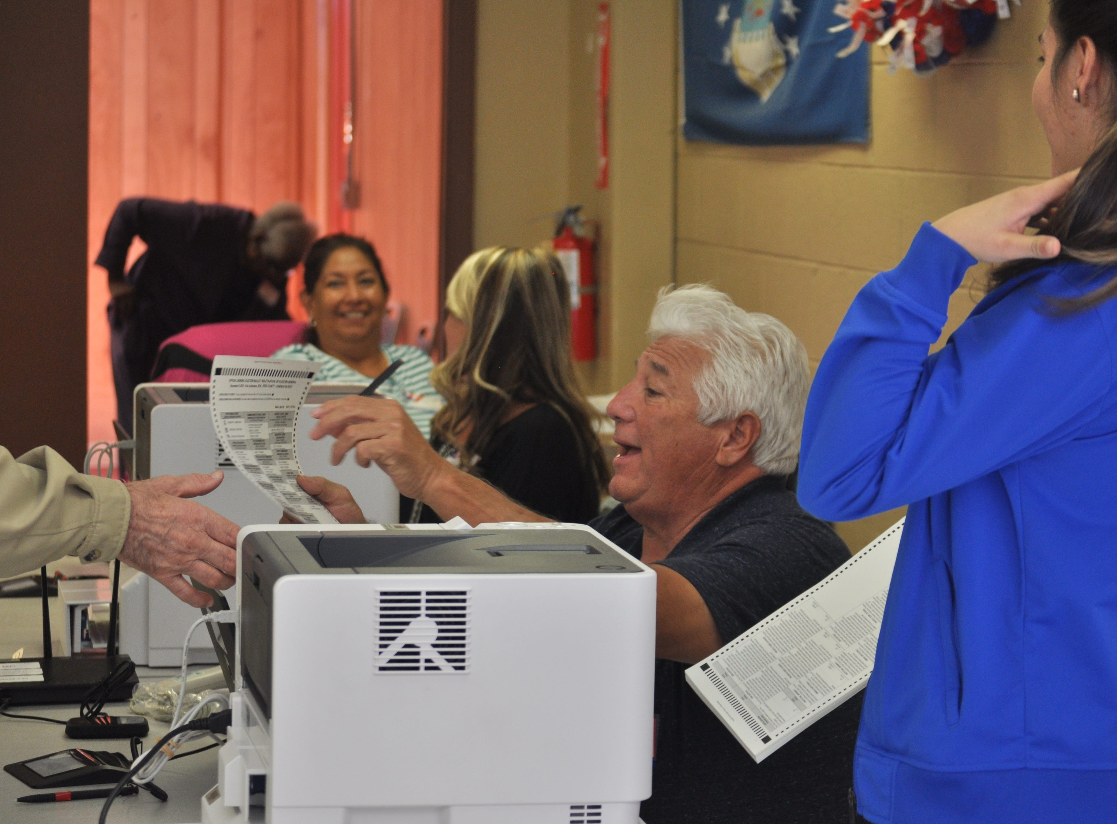 Election clerk Clemente Urquez passes out ballots, Nov. 6, 2018 at the Veterans of Foreign Wars Carlsbad post.