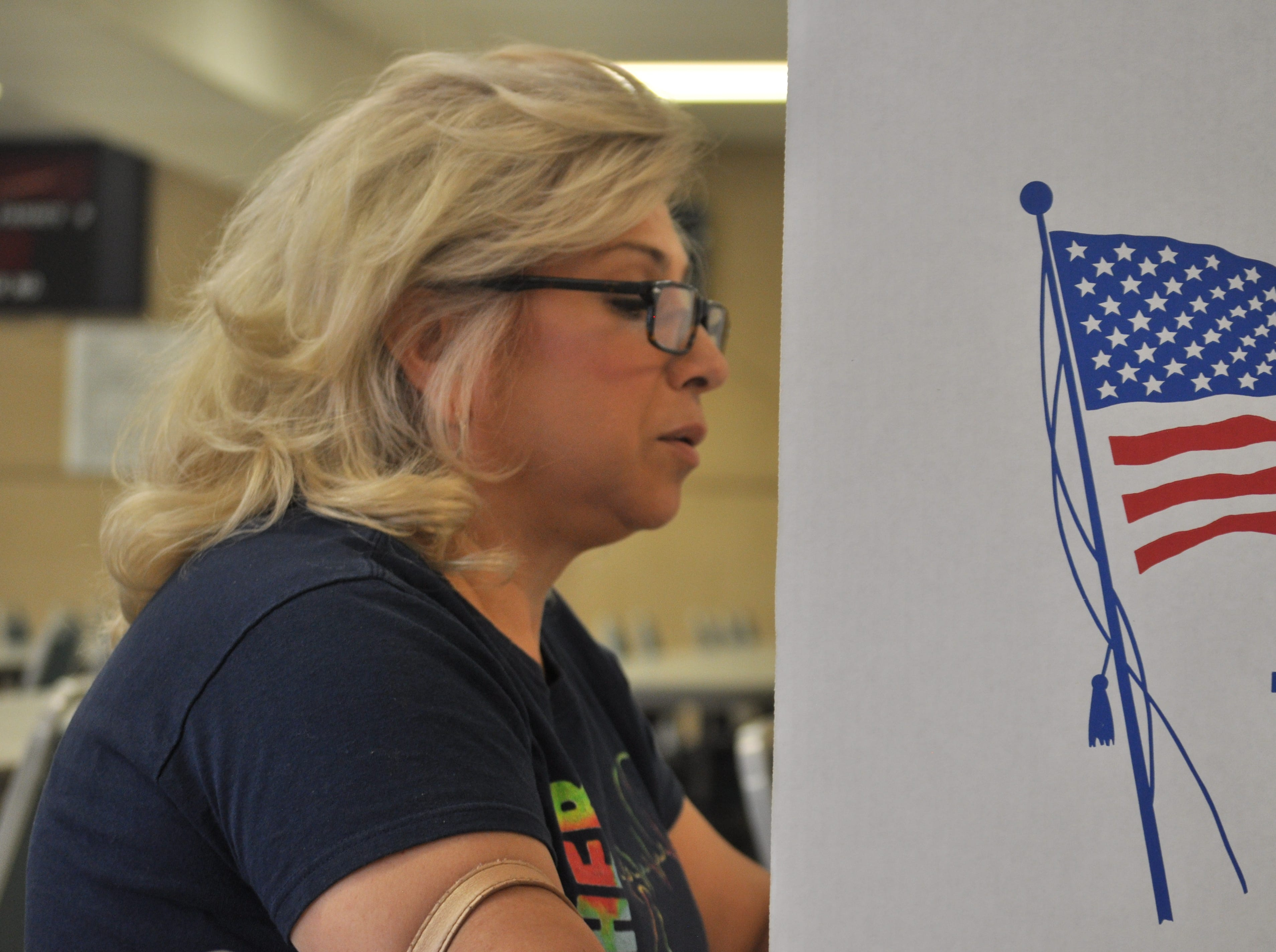 Gwen Lopez casts her ballot, Nov. 6, 2018 at the Veterans of Foreign Wars' Carlsbad post.