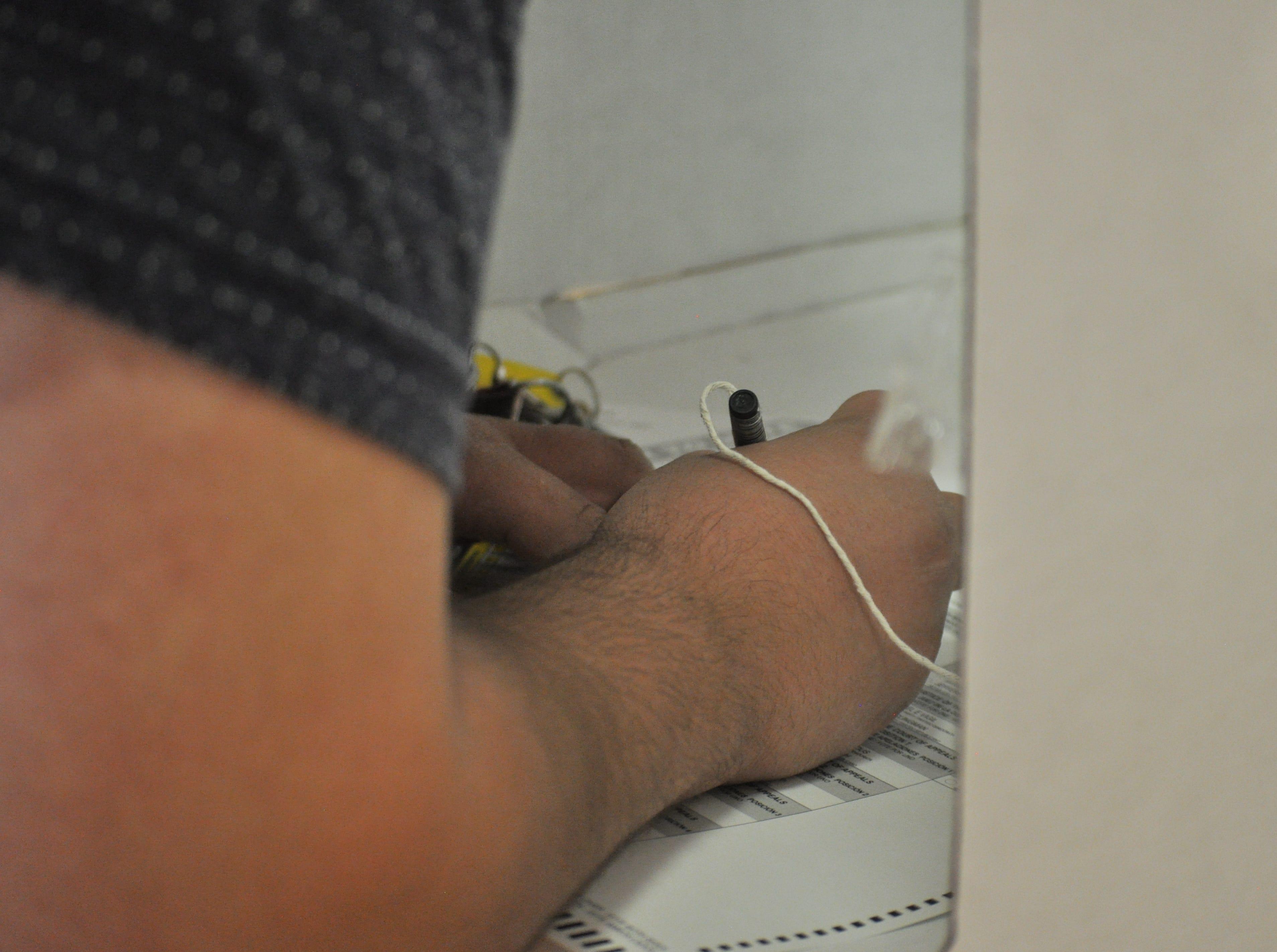 Salomon Soto casts his ballot, Nov. 6, 2018 at Jefferson Montessori Academy.