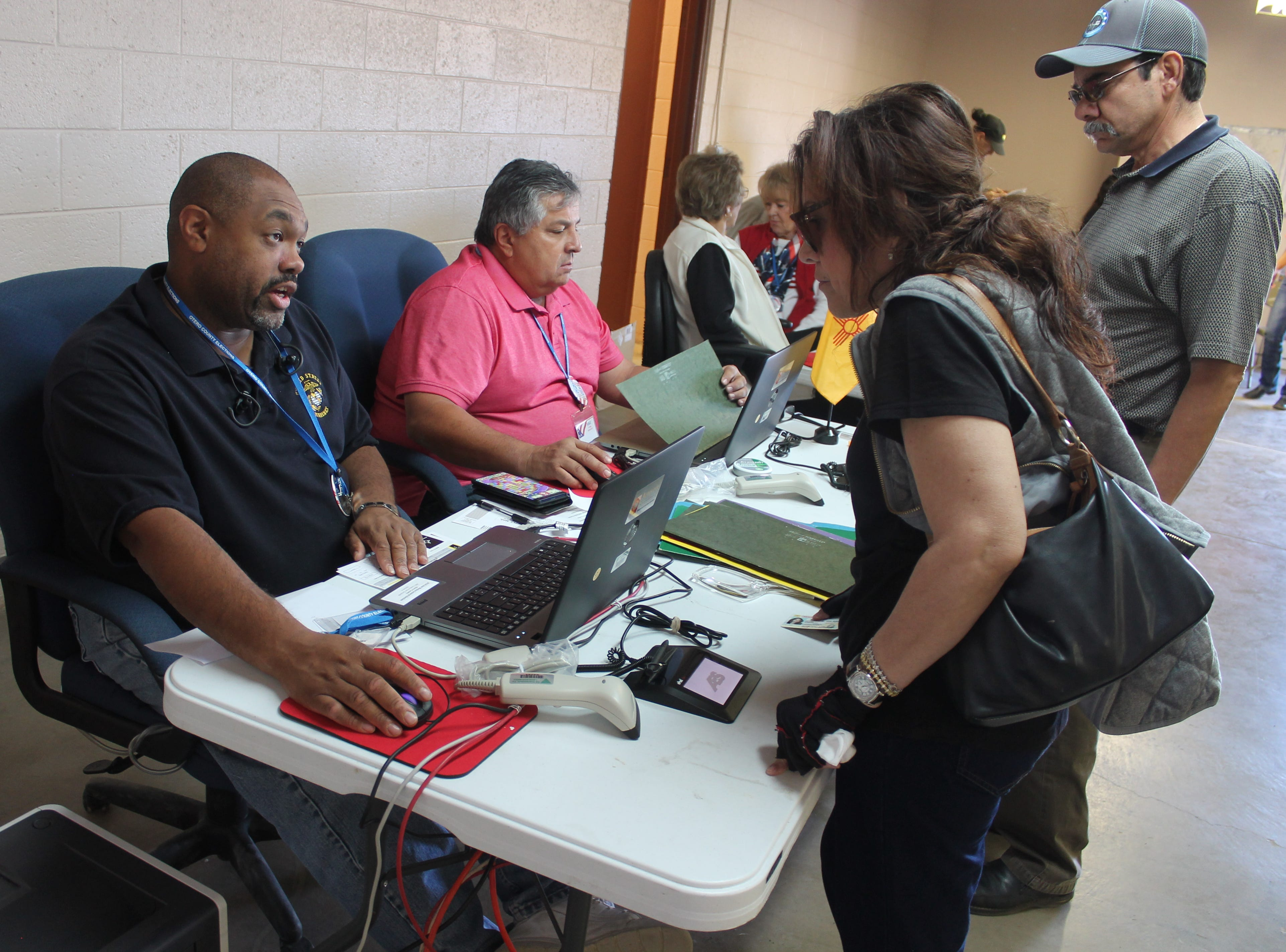 """Everette Brown, left, and Mike Aguirre hand out ballots to Alamogordo residents. The 2018 election was Aguirre's first as a volunteer while Brown has been volunteering as a poll worker since he moved to Alamogordo 11 years ago. """"We've done 654 since 7 this morning,"""" Brown said. """"At one point there was a line going out the door."""""""