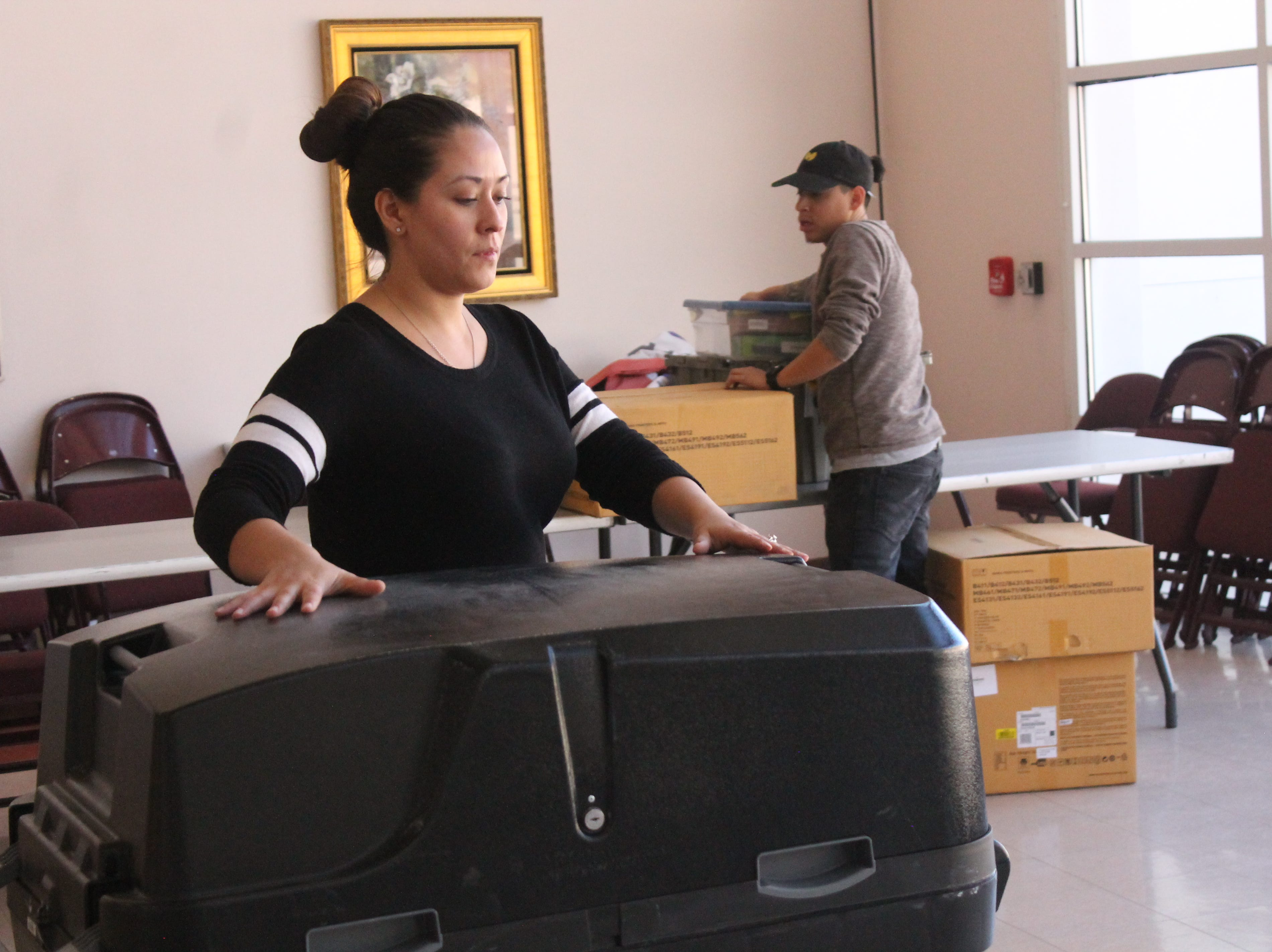 Monique Maynez and Adam Baca work to set up polling stations for the 2018 midterm elections at the Tays Center. Workers began setting up equipment for voting on Nov. 6 began as soon as early voting ended on Nov. 3.