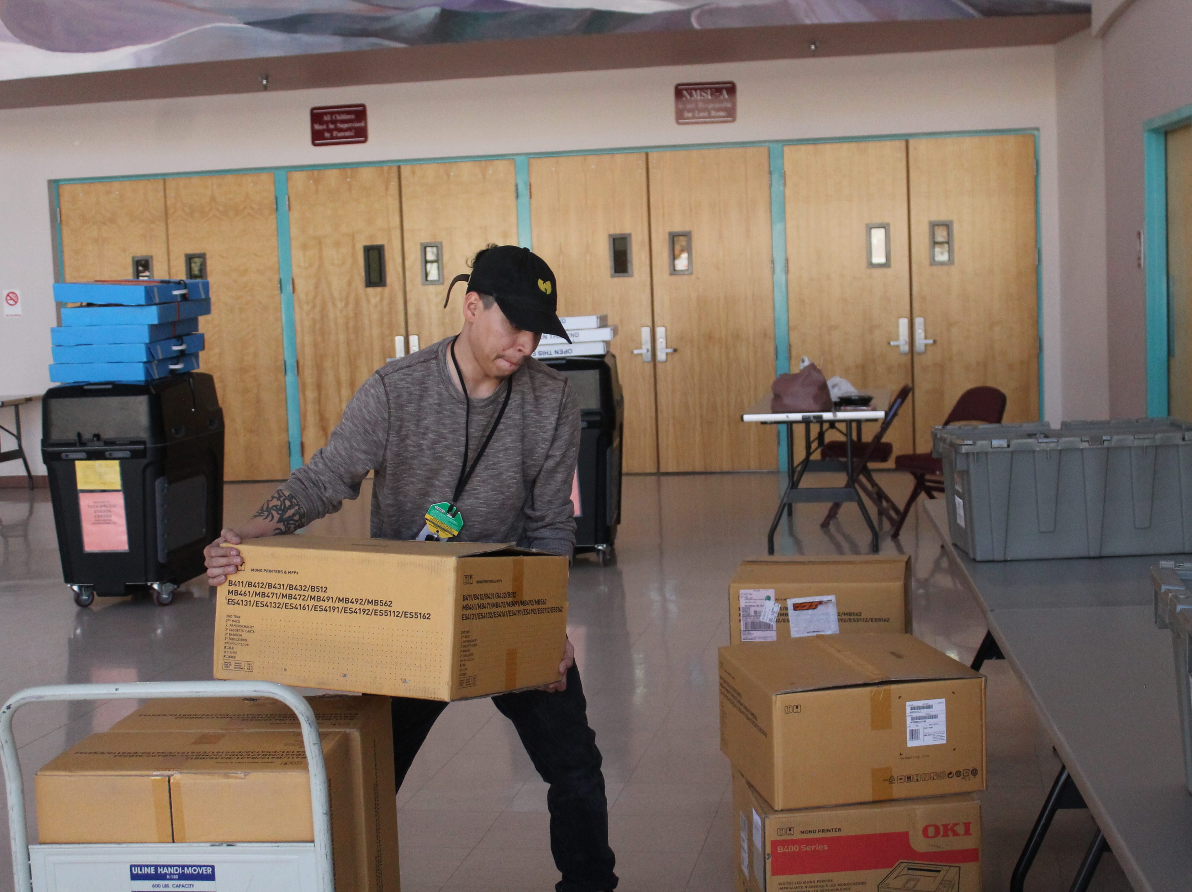 Adam Baca moves supplies into the Tays Center on the New Mexico State University Alamogordo campus in preparation for voting on Nov. 6.