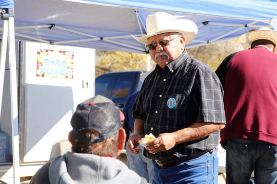 Vern R. Lee, a candidate for the Shiprock Chapter seat on the Navajo Nation Council, visits with voters on Tuesday.