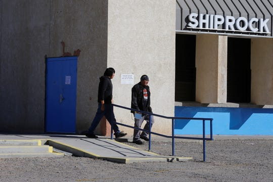 Voters leave the Shiprock Chapter house after casting ballots in the Navajo Nation general election on Tuesday.