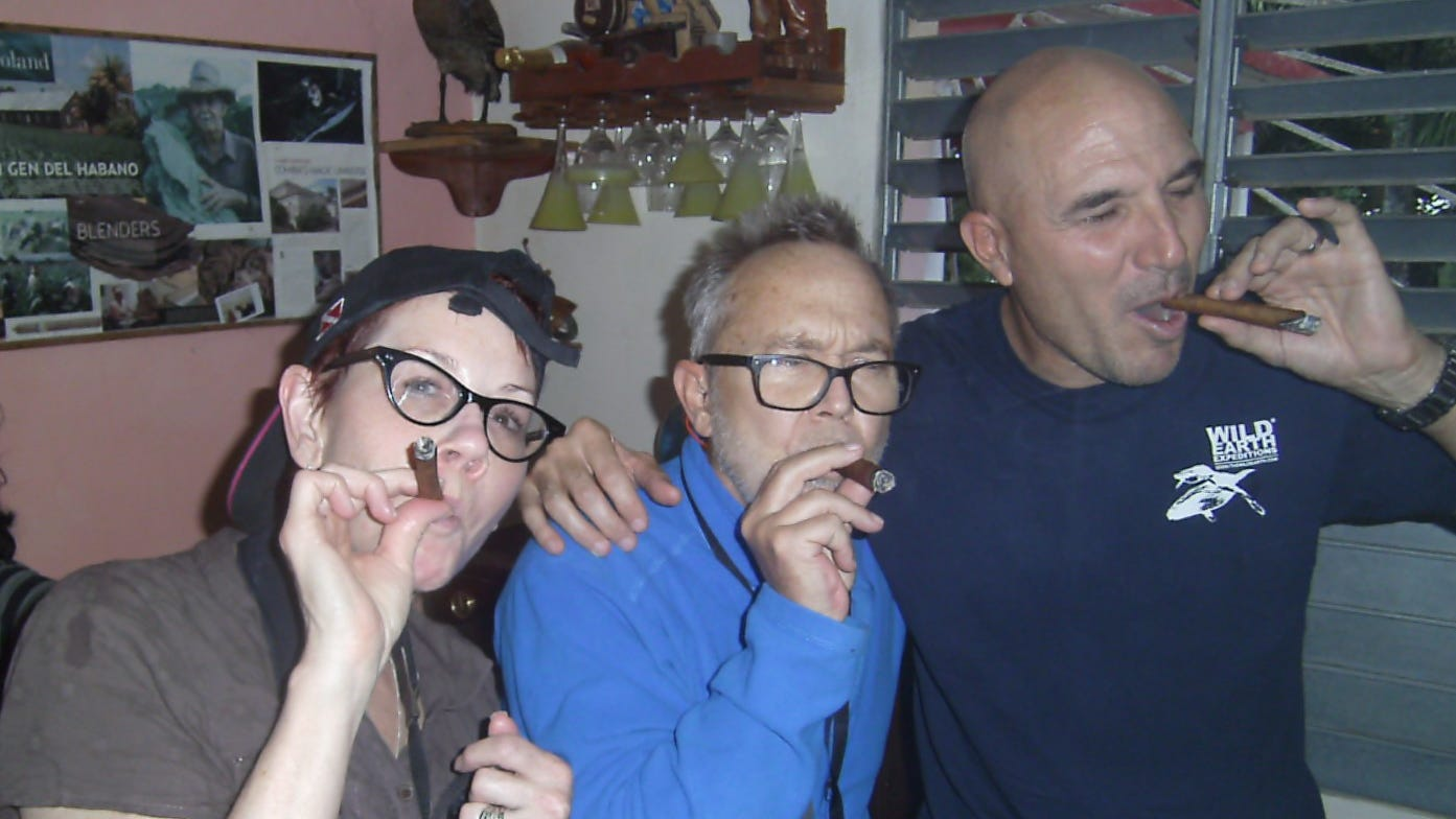 Three People to People Humanitarians sample cigars in Cuba's Pinar del Rio province.