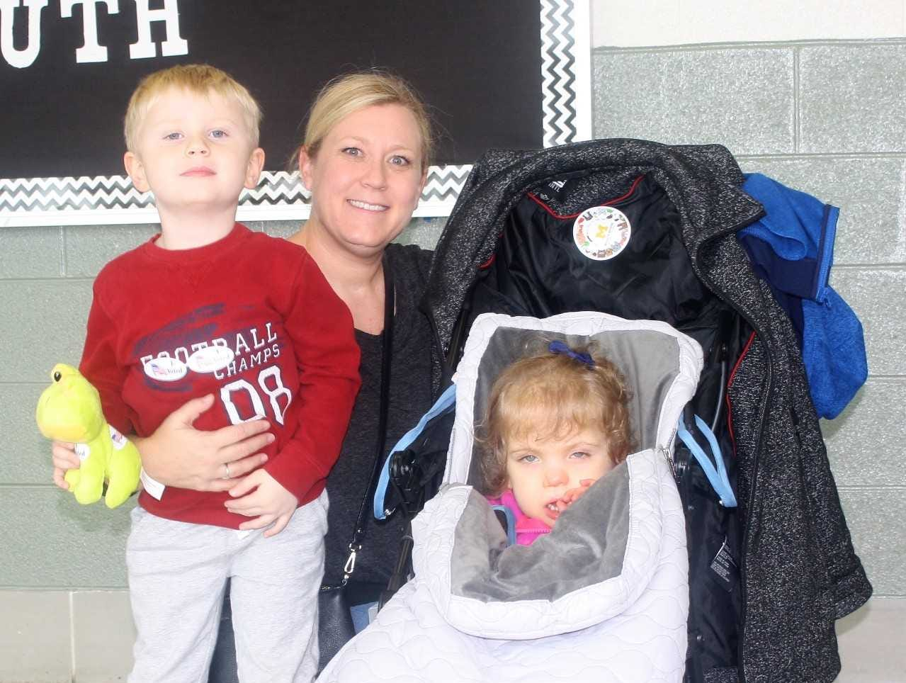 Marie Alpier is pictured with her childen Nicholas and Brynn after she voted at Plymouth High School.